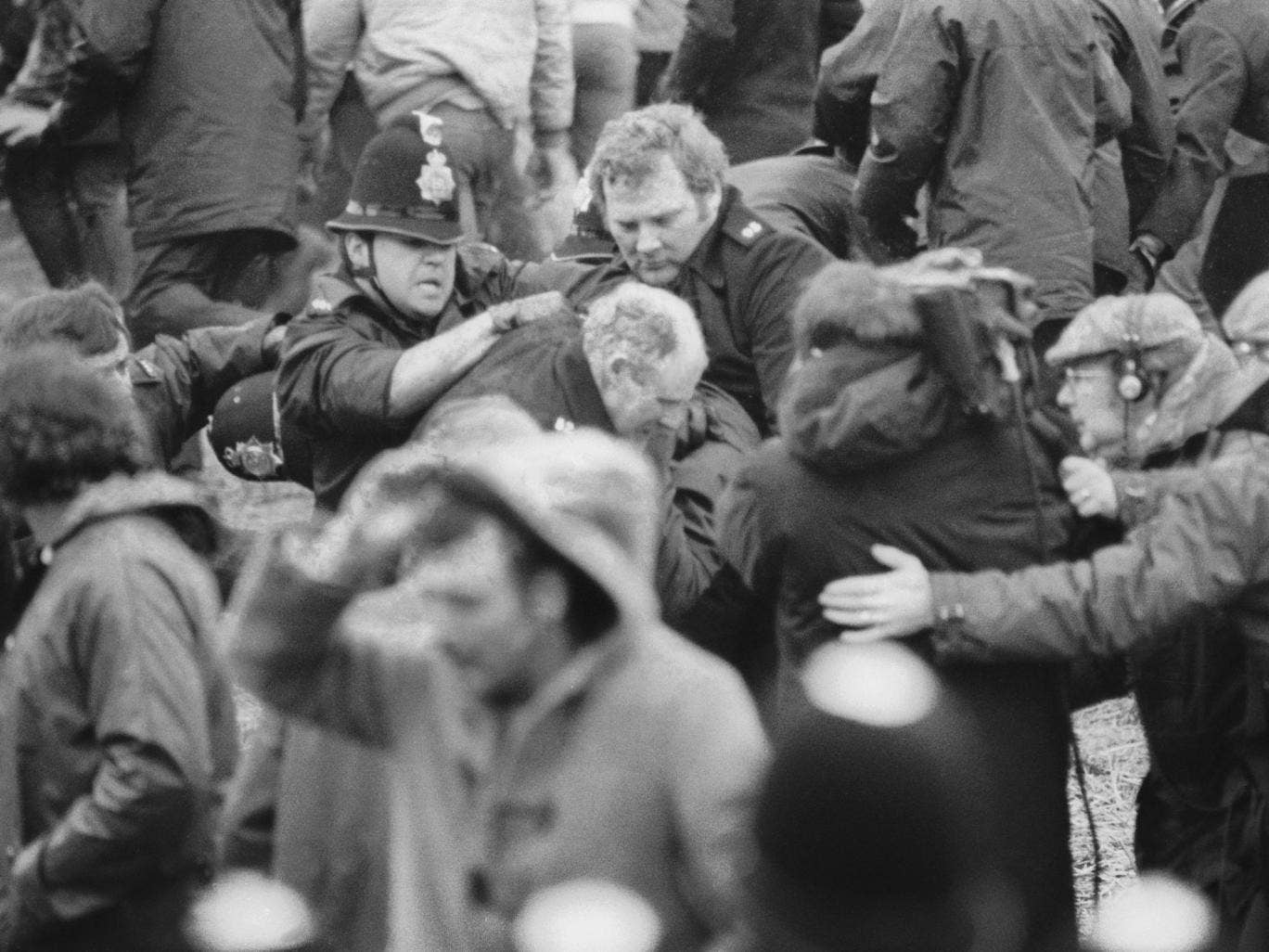 A camera crew fims a scuffle between police and miners at a demonstration at Orgreave Colliery, South Yorkshire, during the miner's strike, 2nd June 1984 - All police forces in England and Wales have been asked to search their files over claims that offic