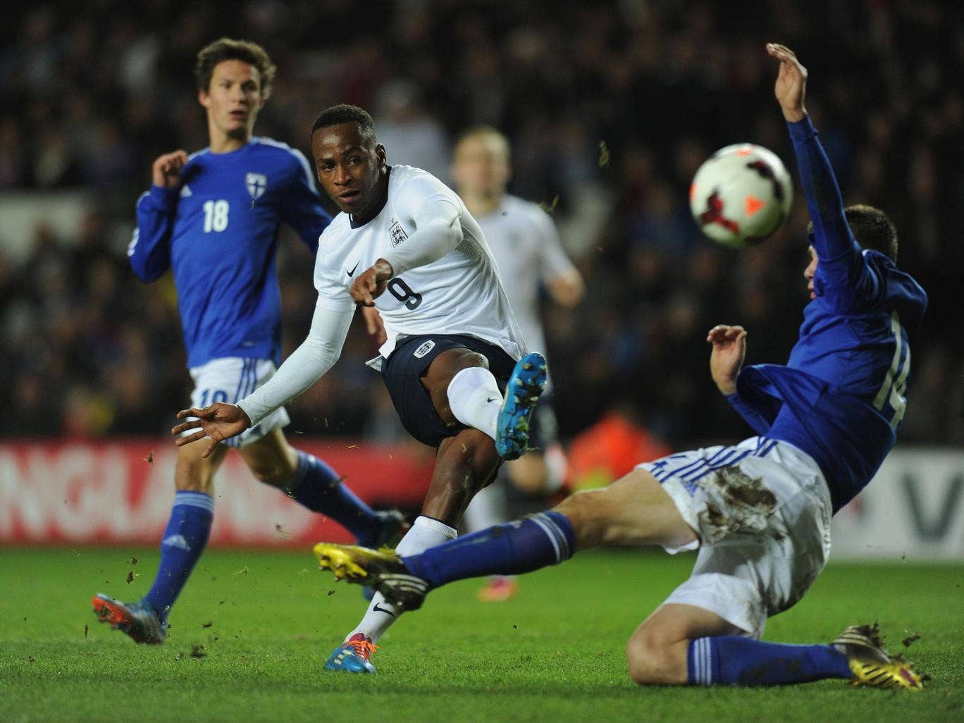England Under-21 striker Saido Berahino fires past Daniel O'Shaunessy of Finland Under-21s