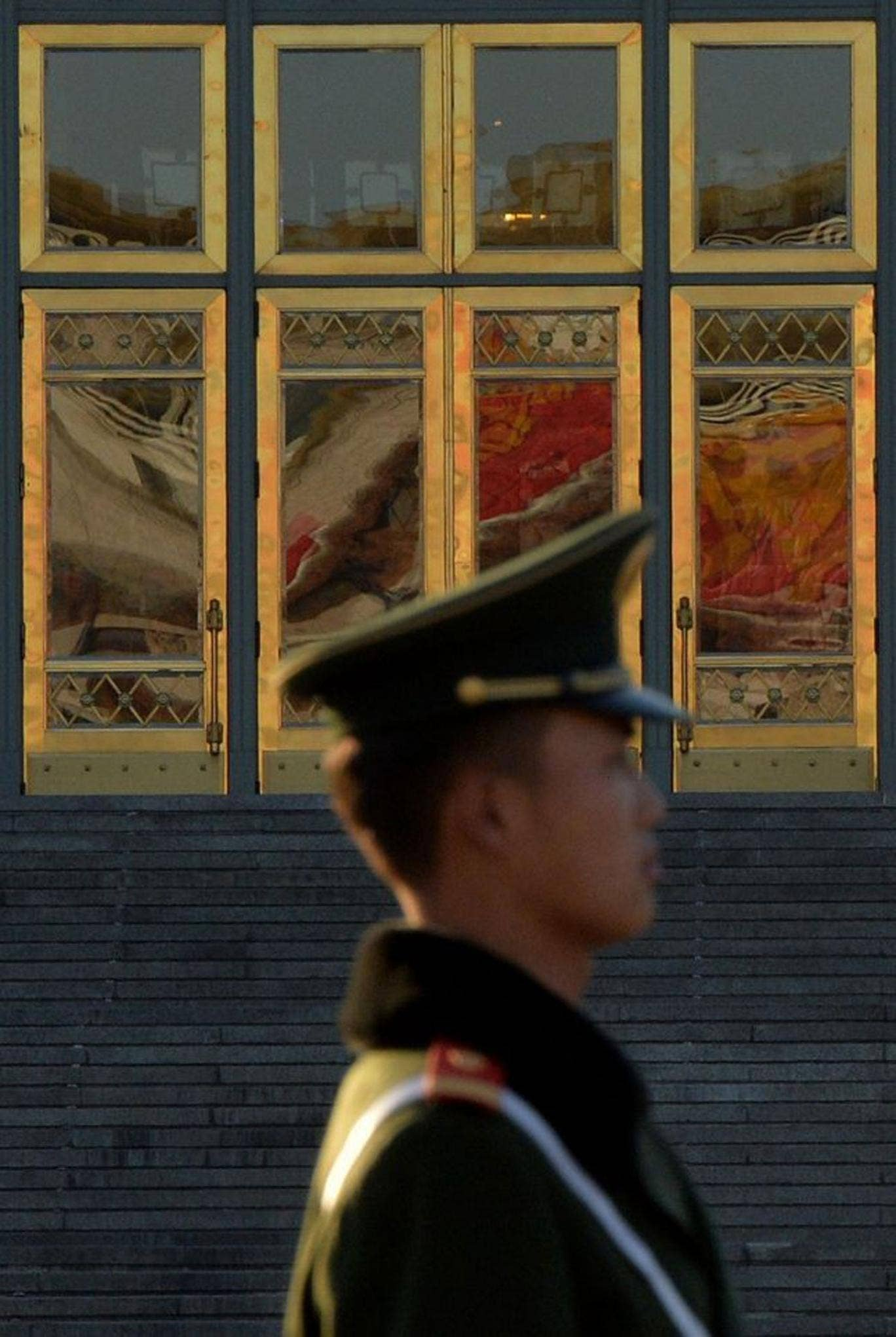 A Chinese paramilitary police officer stands guard in Beijing after the third Plenum