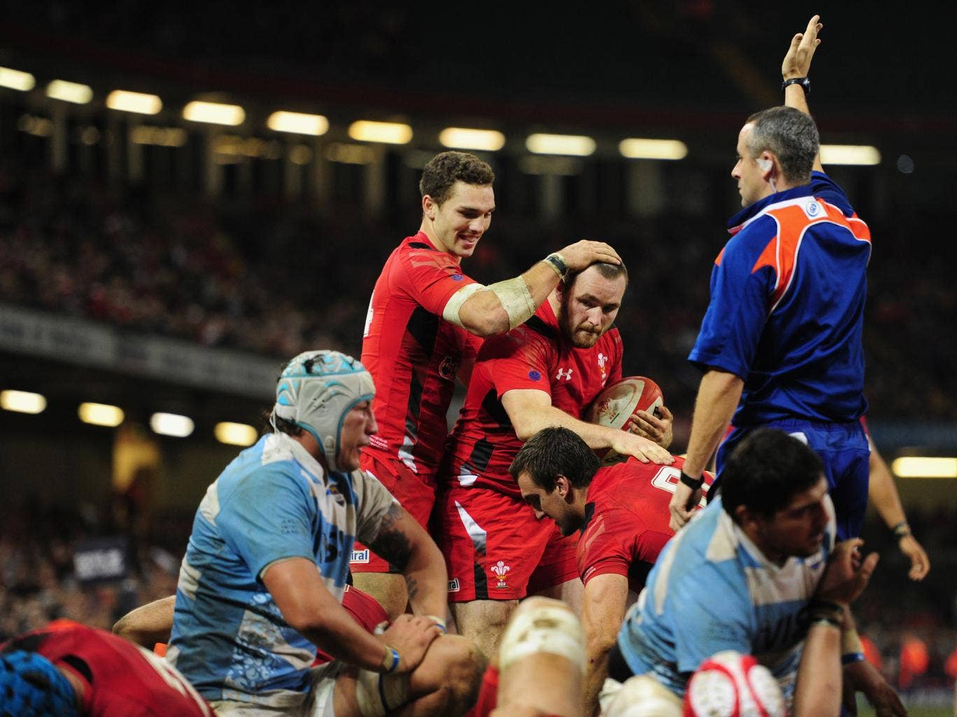 Ken Owens celebrates with George North after scoring Wales' fourth try