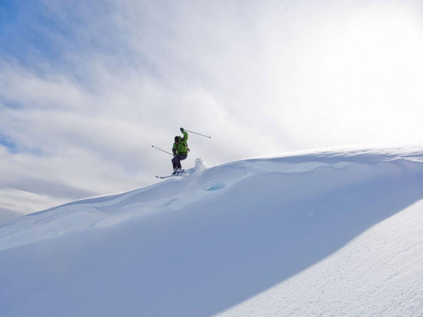 A skier flies through the air