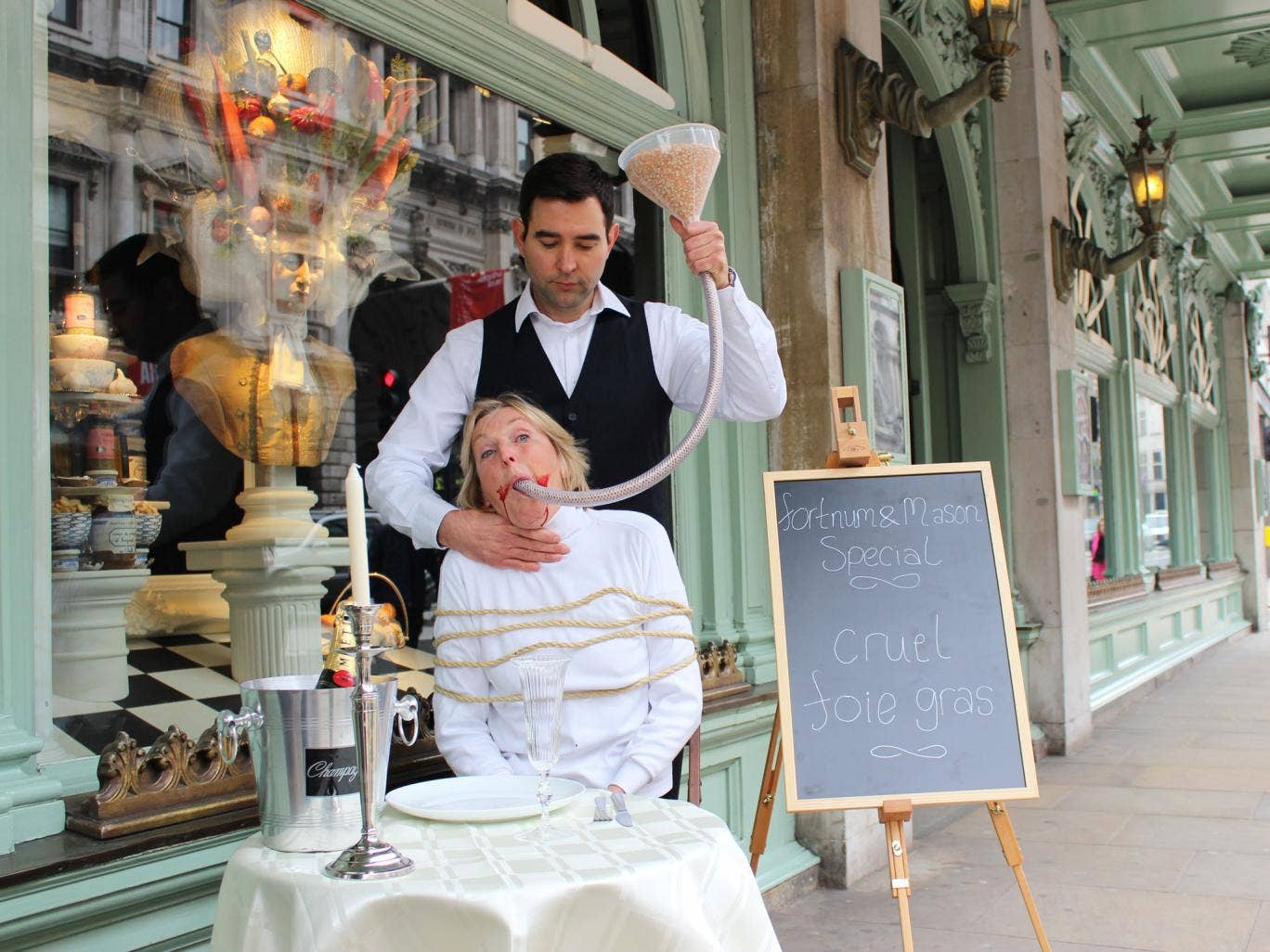 Ingrid Newkirk outside Fortnum & Mason with a bloodied mouth and feeding tube