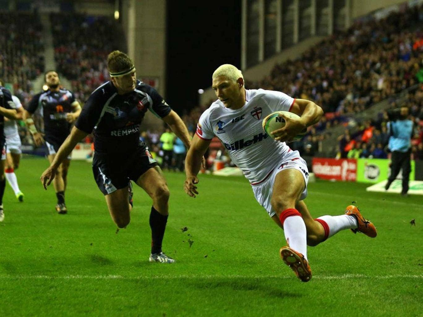 Ryan mighty: England's winger Ryan Hall scores his second try last night