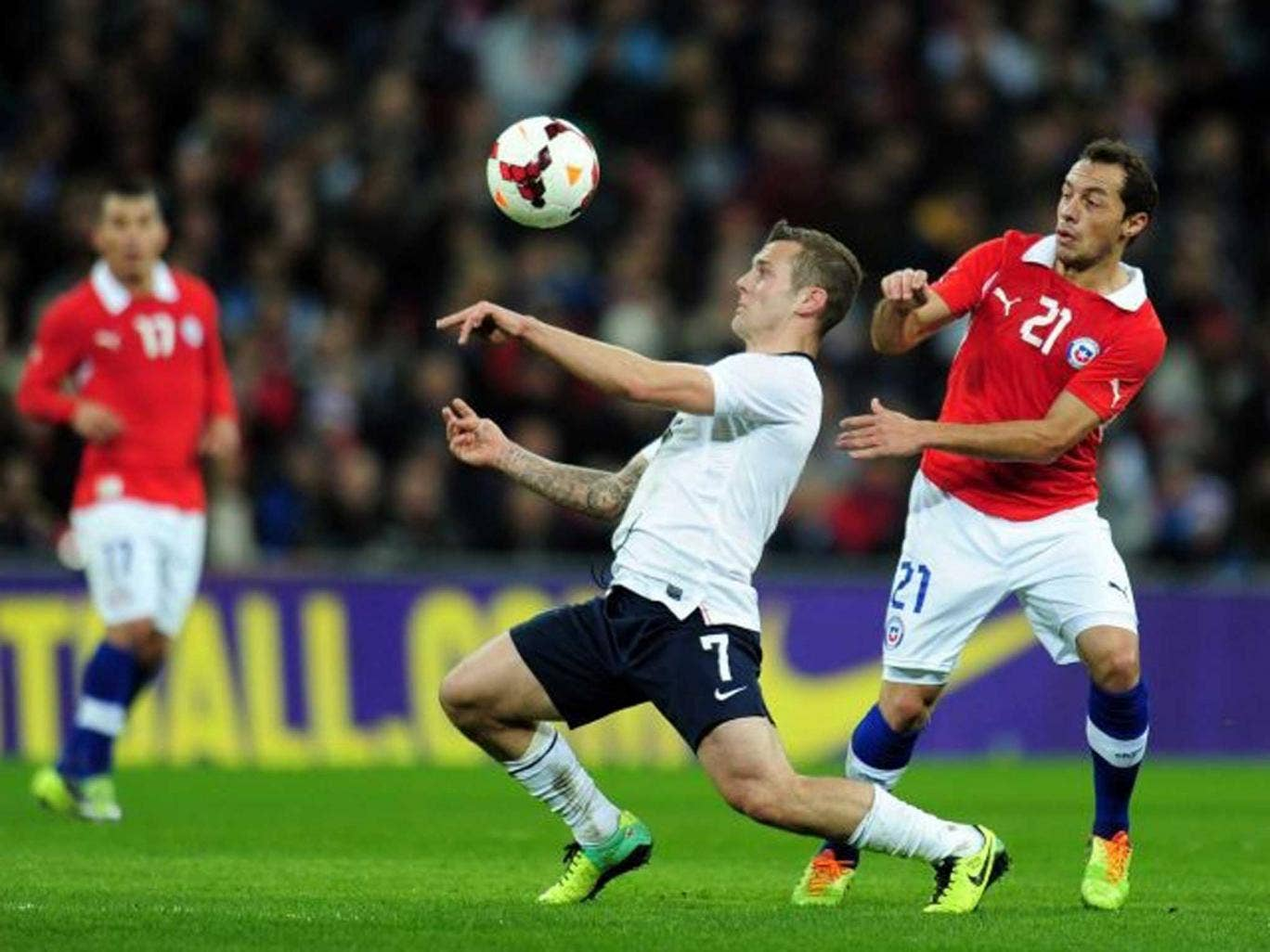 The eyes have it: Jack Wilshere, England's key midfielder, shields the ball from Chile's Marcelo Diaz at Wembley on Friday