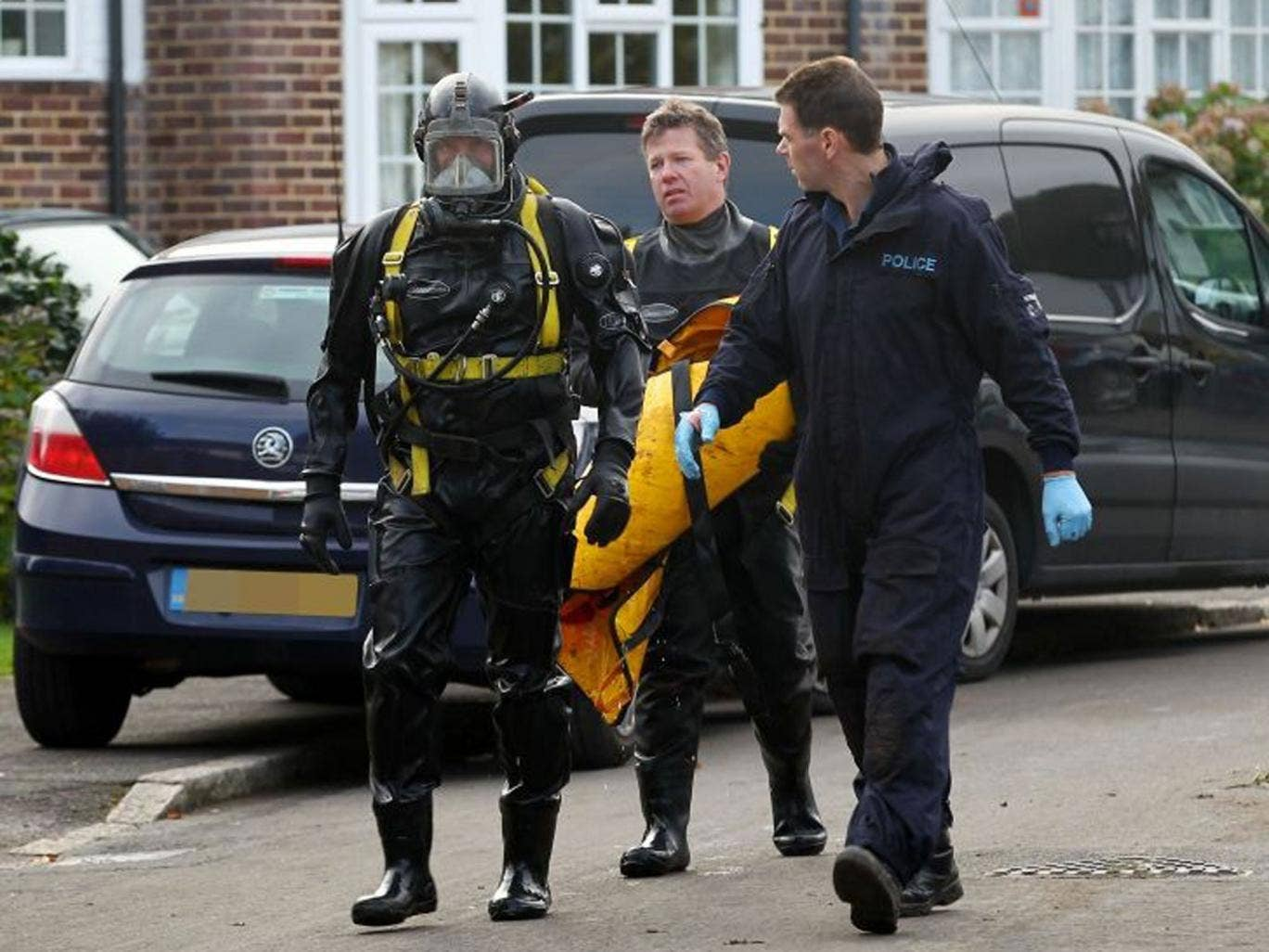 Officers from the Underwater and Confined Space Search Team during the recovery operation of a body that was discovered in a well in Surrey