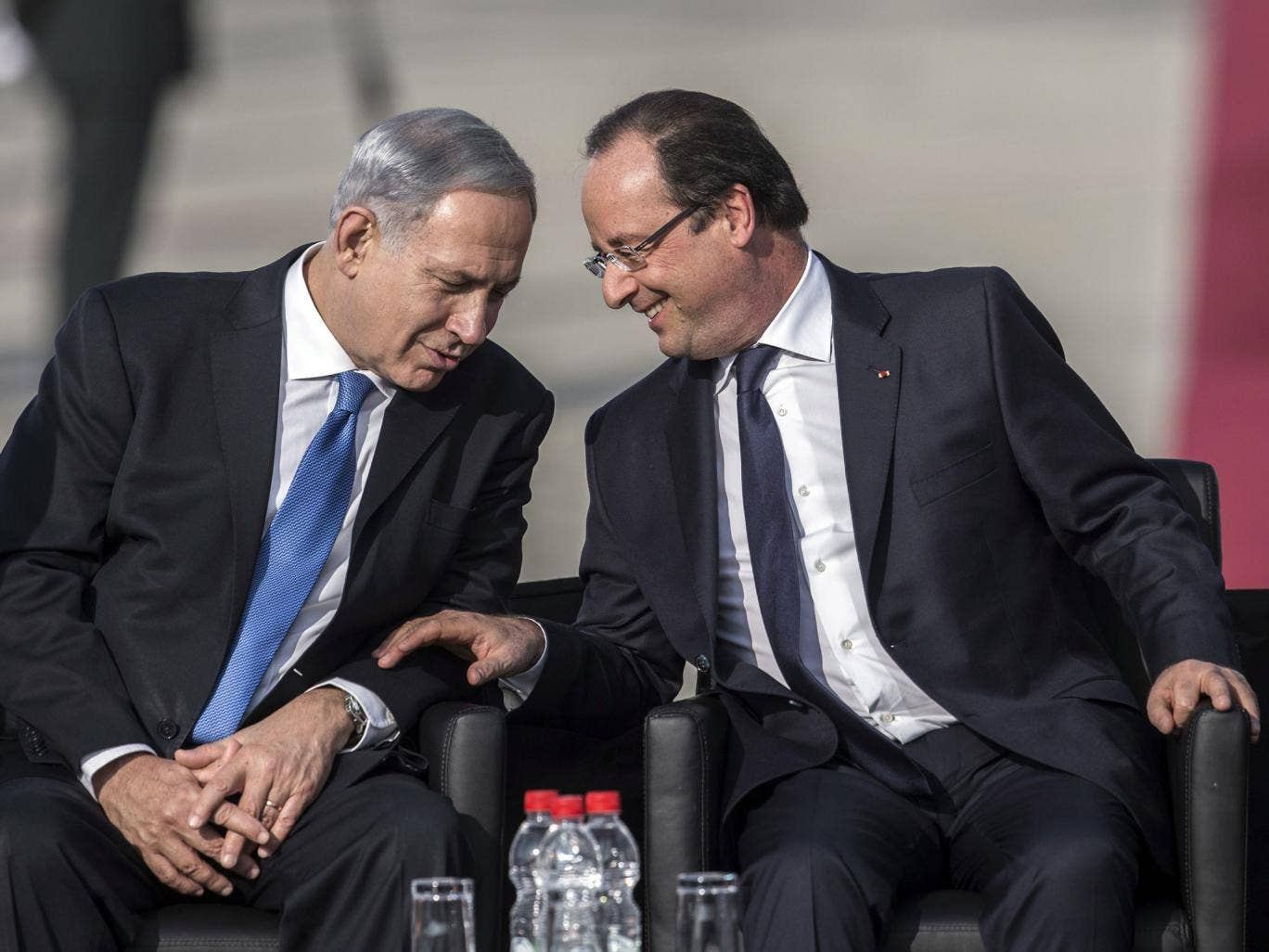 Israel's Prime Minister Benjamin Netanyahu, left, with the French President Francois Hollande, right, said France was a 'true friend' in Tel Aviv