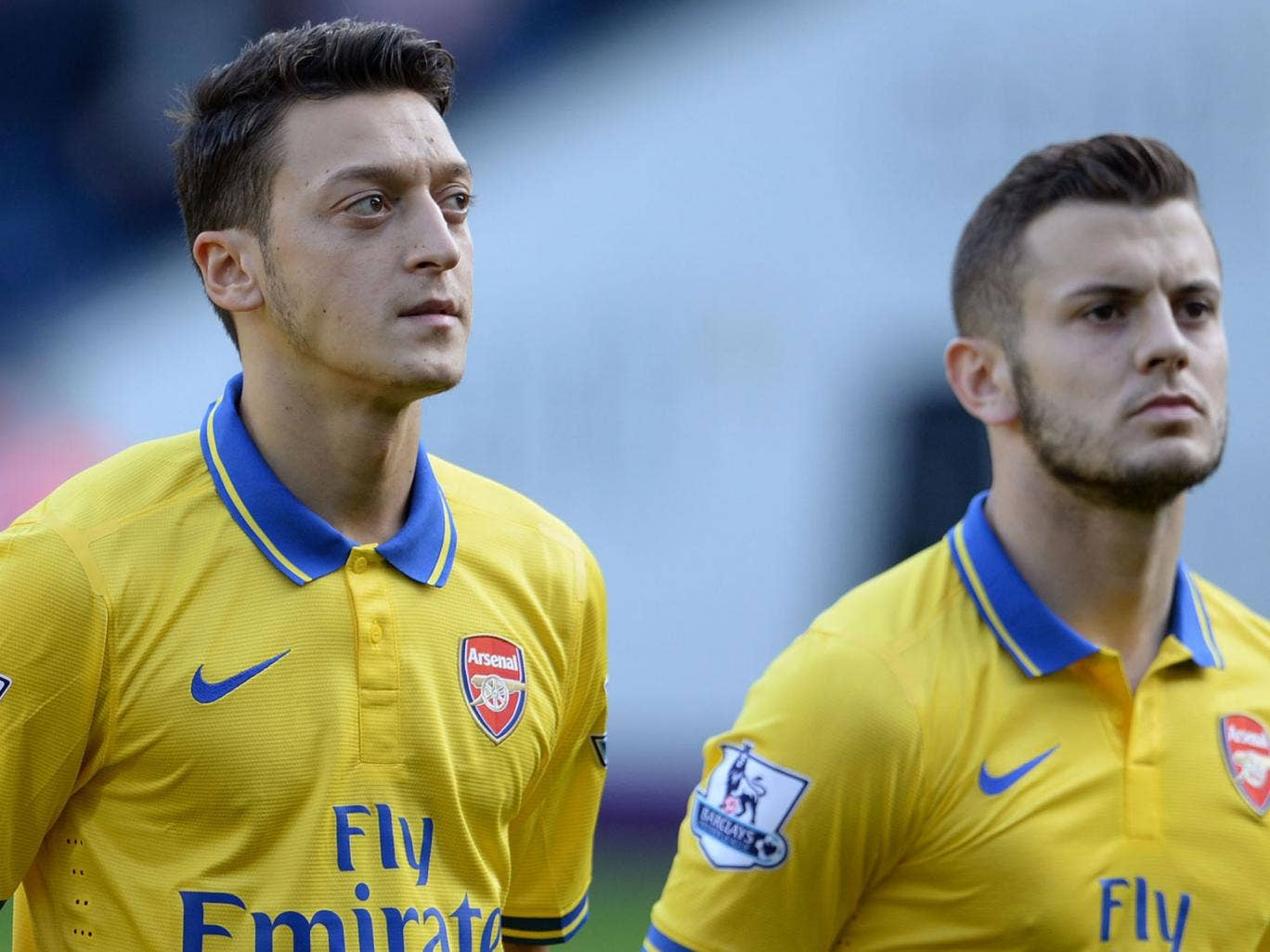 Mesut Ozil (left) and Jack Wilshere line up for Arsenal