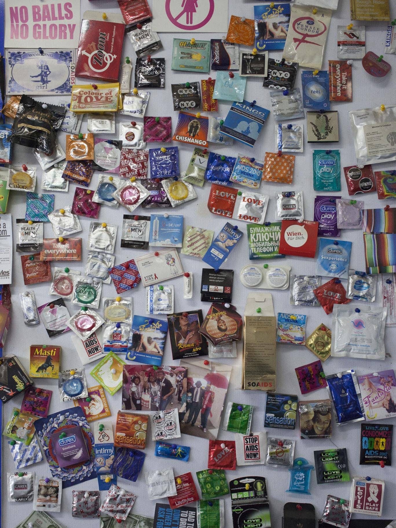 A wall is covered in different condom brands