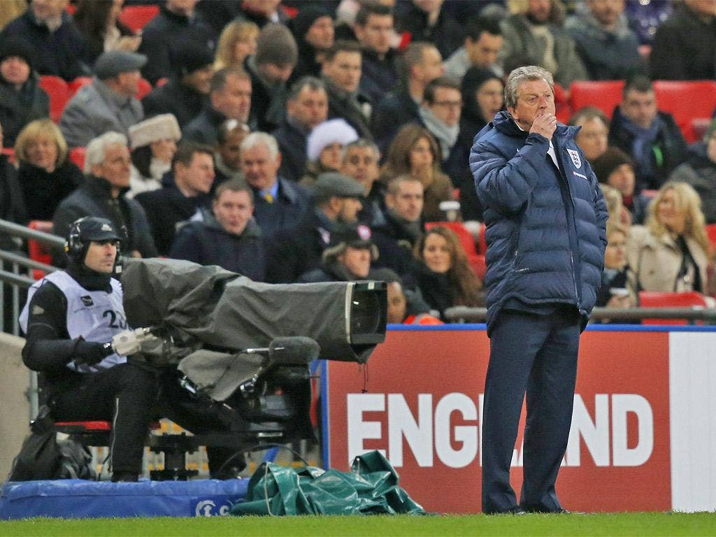 A pensive Roy Hodgson watches England lose to Germany at Wembley on Tuesday