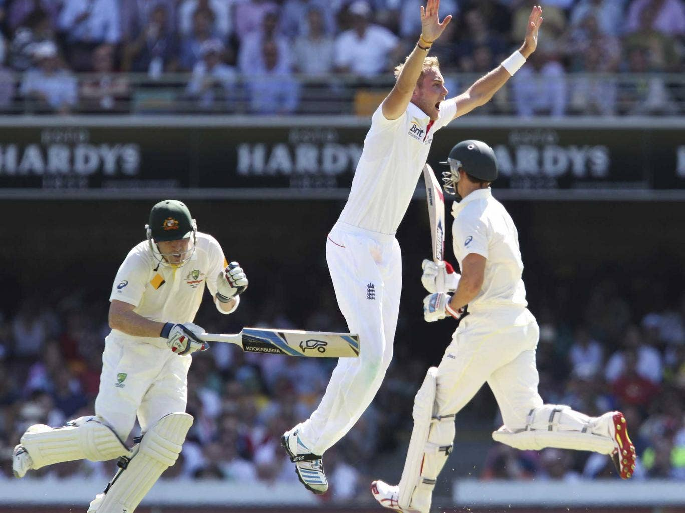 England's Stuart Broad, centre, clashes with Australia's Brad Haddin