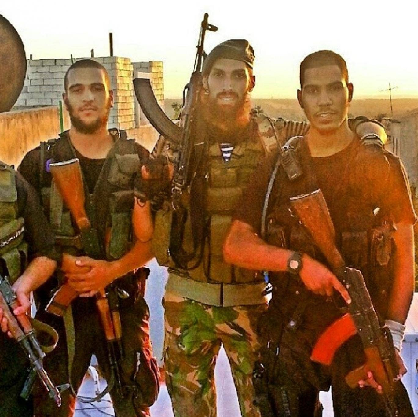 A photograph taken in Syria and uploaded by Instagram user @chechclearr, shows Mohammed el-Araj, 23, from West London (left), alongside a fellow British man (right) and the former Dutch soldier who trained them (centre)