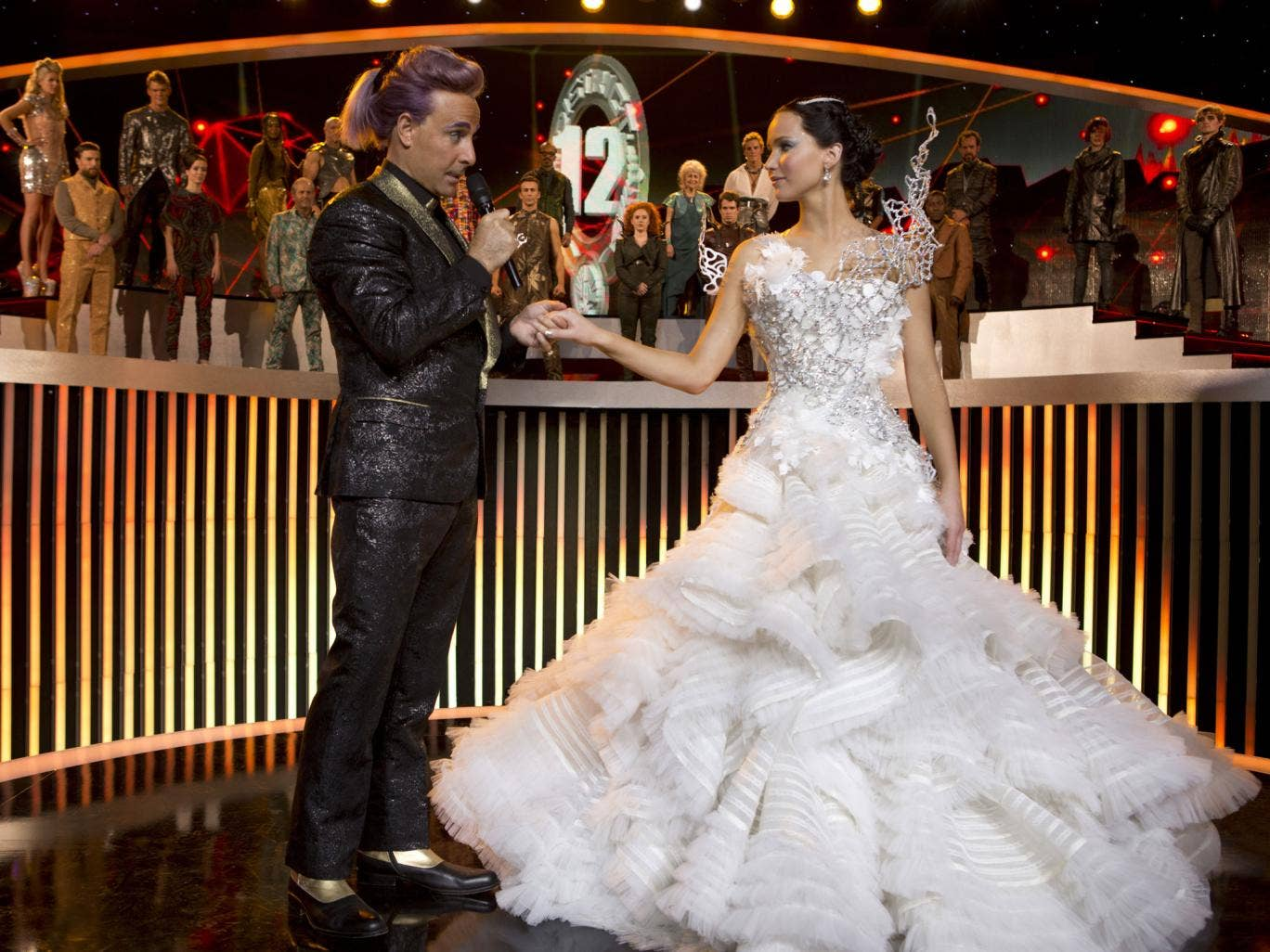 Glad hand: Stanley Tucci and Jennifer Lawrence in 'Hunger Games: Catching Fire'