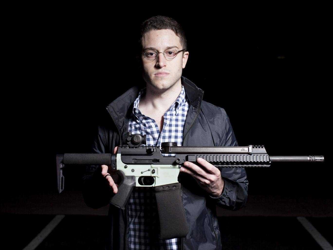 The gift that keeps on giving: Cody Wilson with an AR-15 gun. It has a 3D-printed lower receiver