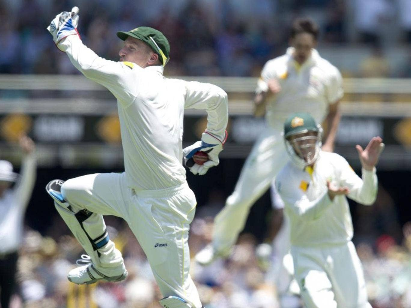 Australian wicket keeper Brad Haddin (left) celebrates after catching out England's batsman Jonathan Trott (not pictured) from the bowling of Mitchell Johnson on day two