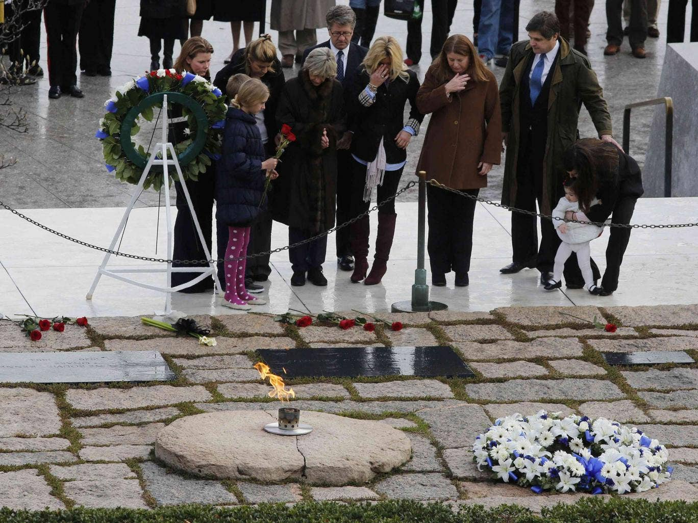 Members of the Kennedy family pay their respects at Arlington National Cemetery to mark the 50th anniversary of the assassination of former U.S. President John F. Kennedy