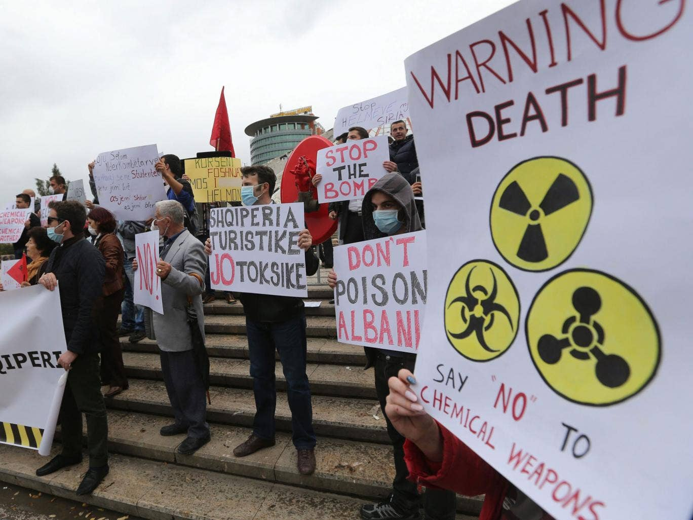 Albanian citizens hold placards during a protest against chemical weapons in front of Albanian Prime Minister's office in Tirana - the country came close to receiving the chemicals