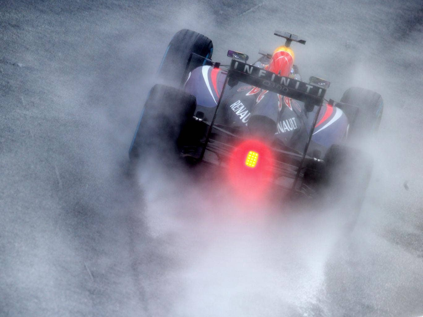 Sebastian Vettel of Germany and Infiniti Red Bull Racing drives on his way to finishing first