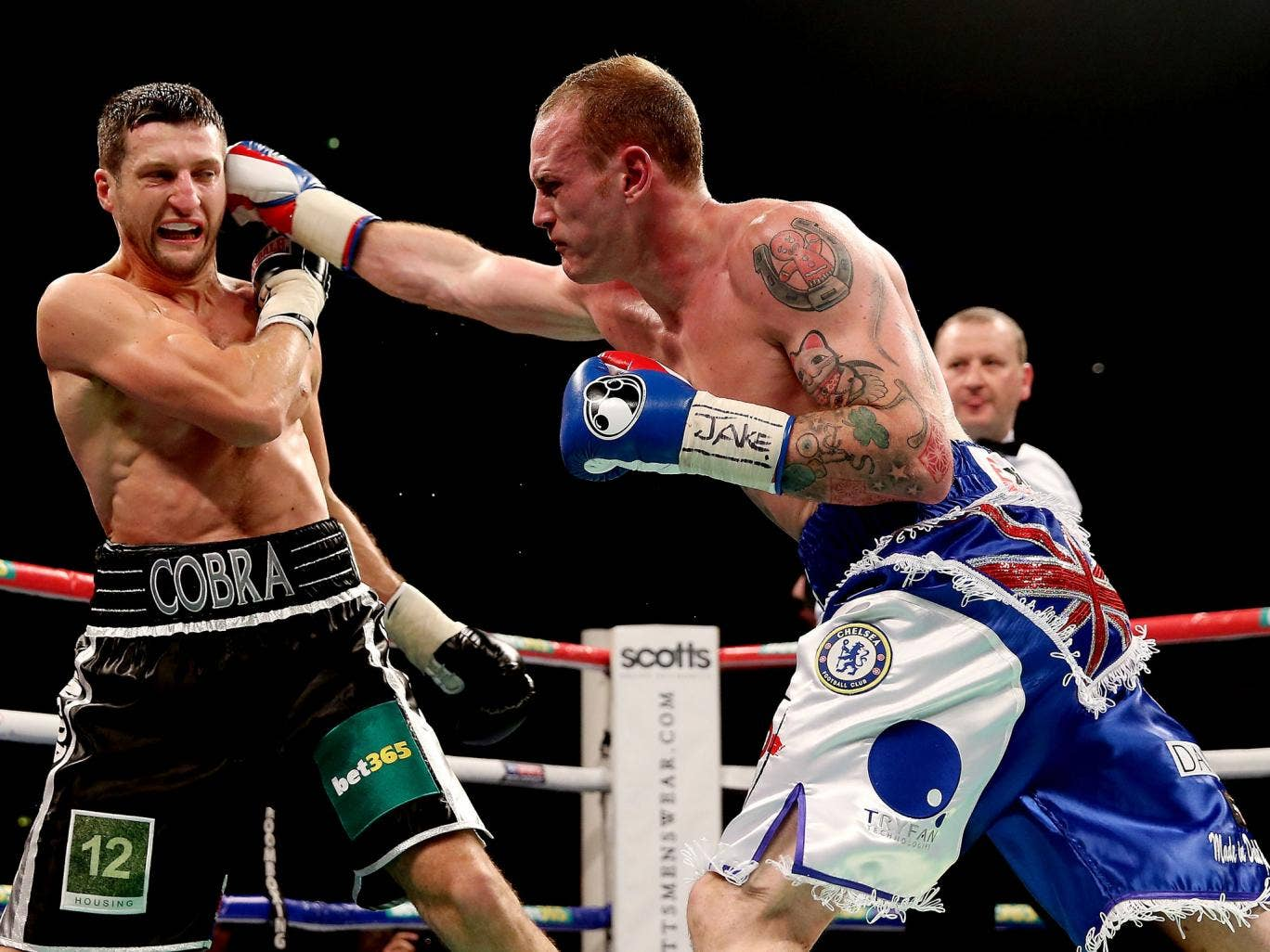 Carl Froch (L) in action with George Groves
