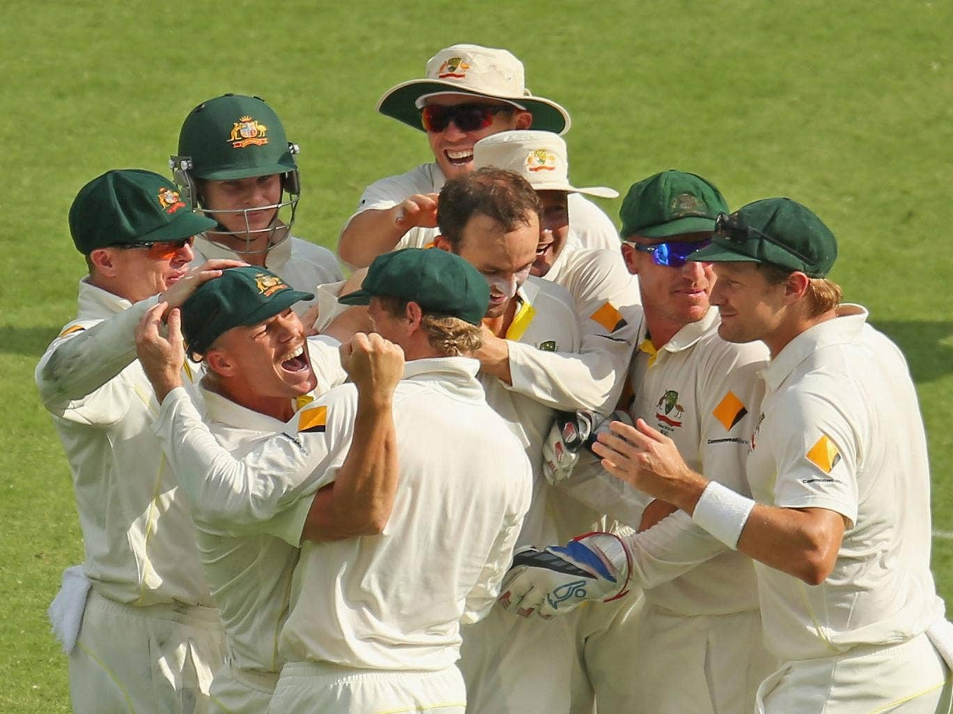 The Australian players celebrate another wicket on their way to victory over England