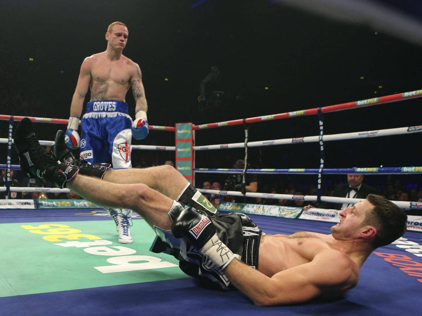 George Groves puts Carl Froch on the canvas during their super-middleweight title fight