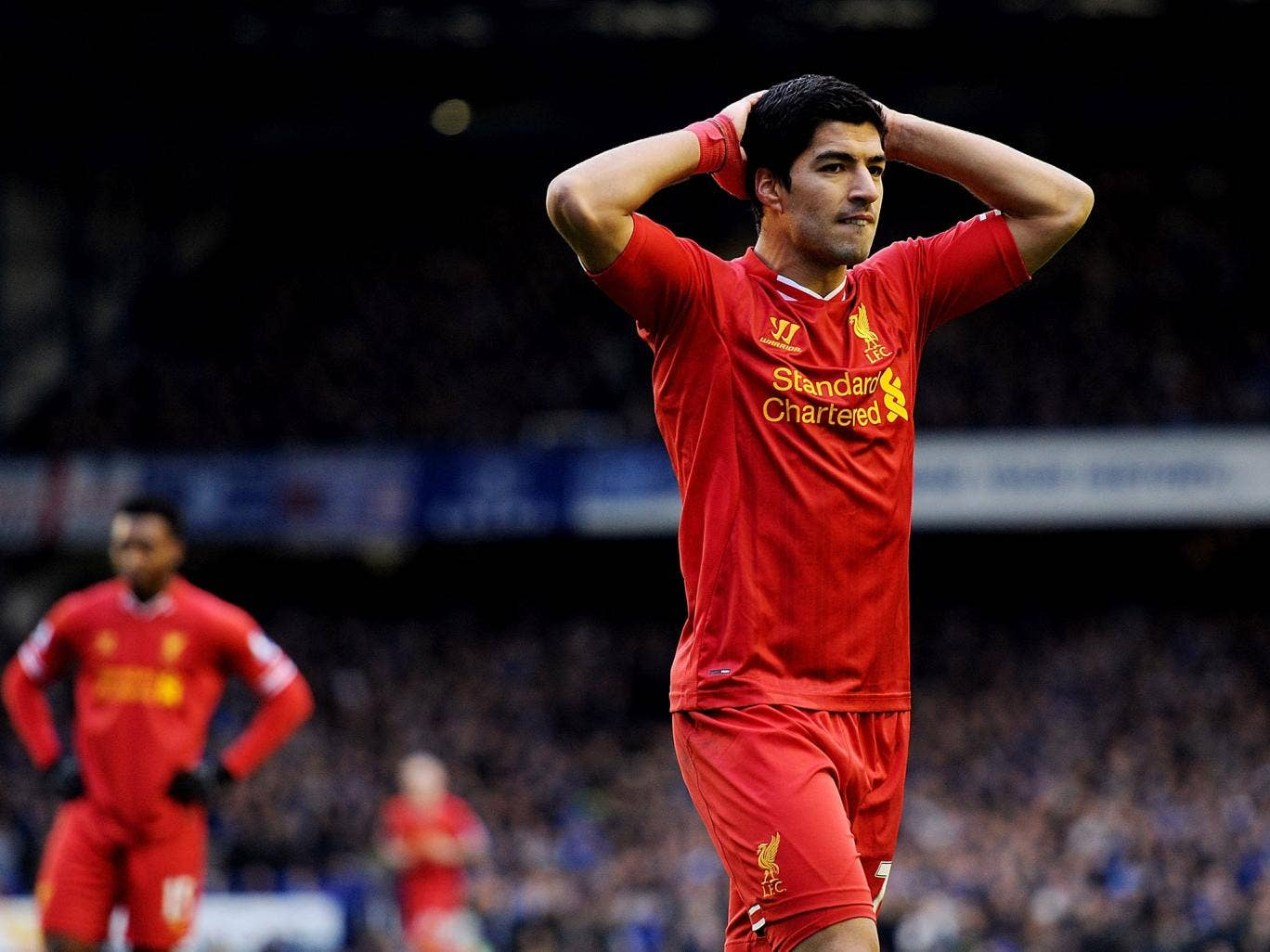 Luis Suarez looks dejected after missing a late chance to hand Liverpool victory against Merseyside rivals Everton