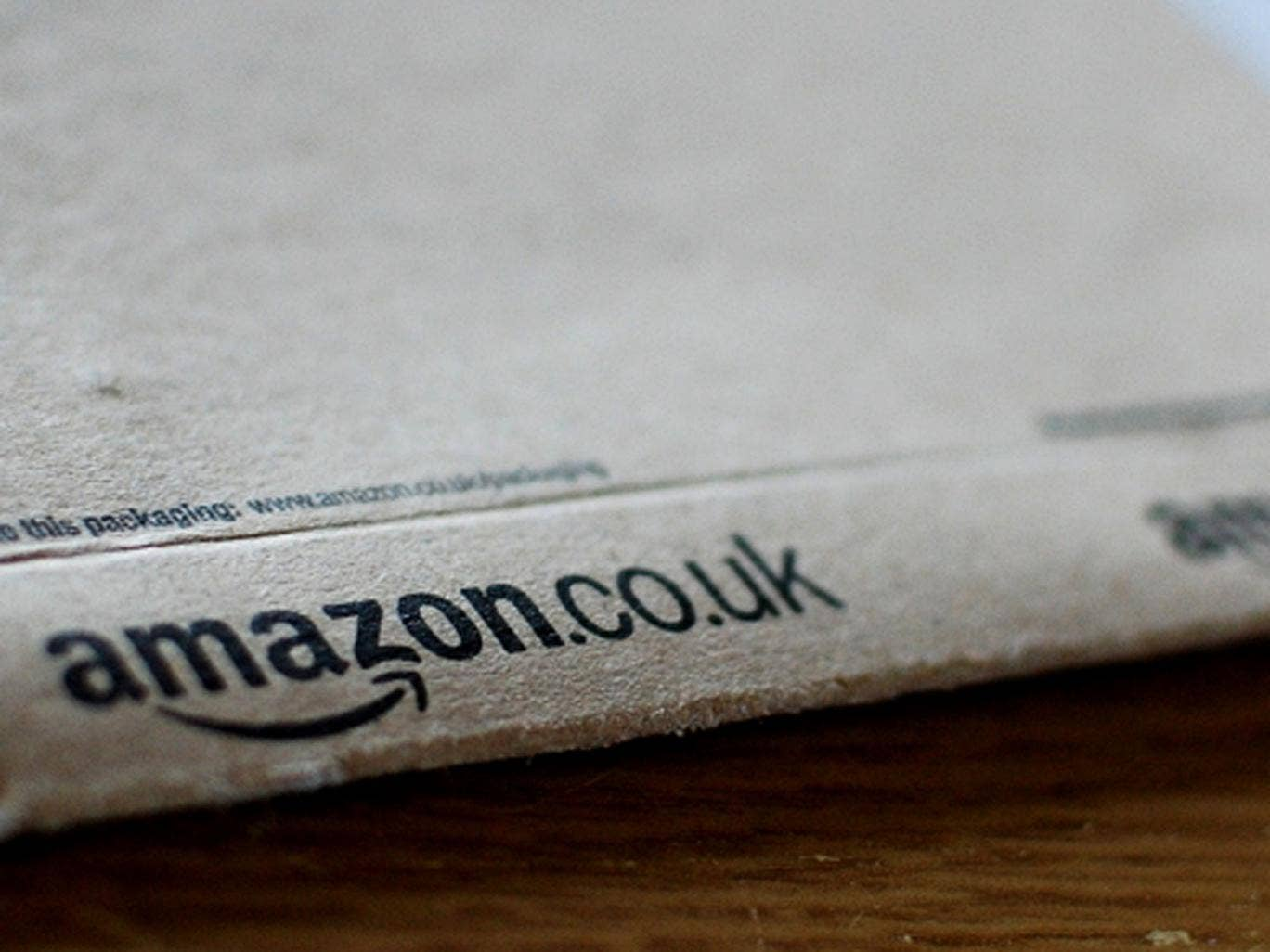 Amazon is to take on 15,000 extra staff for the Christmas period