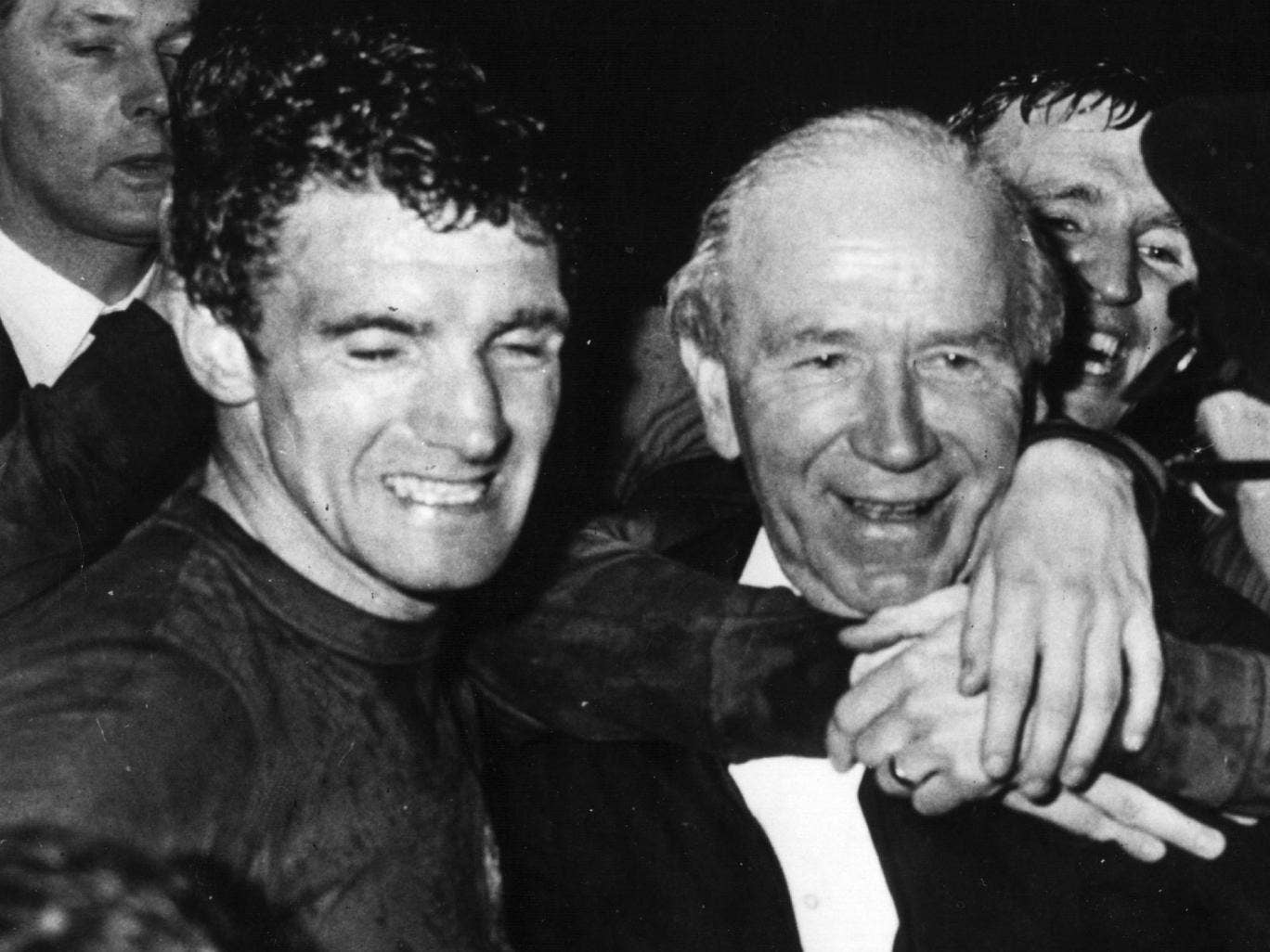 Manchester United manager, Matt Busby, with Bill Foulkes (left) celebrating their 4-1 victory over Benfica in the European Cup Final at Wembley