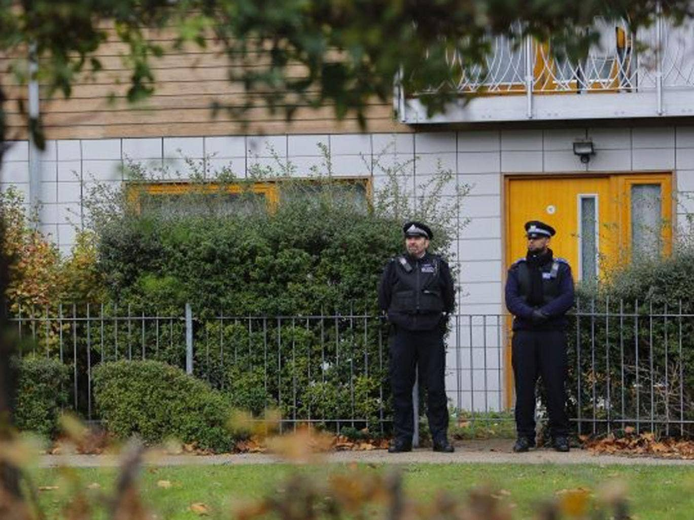 Police guard the flats being investigated in connection with an alleged slavery case