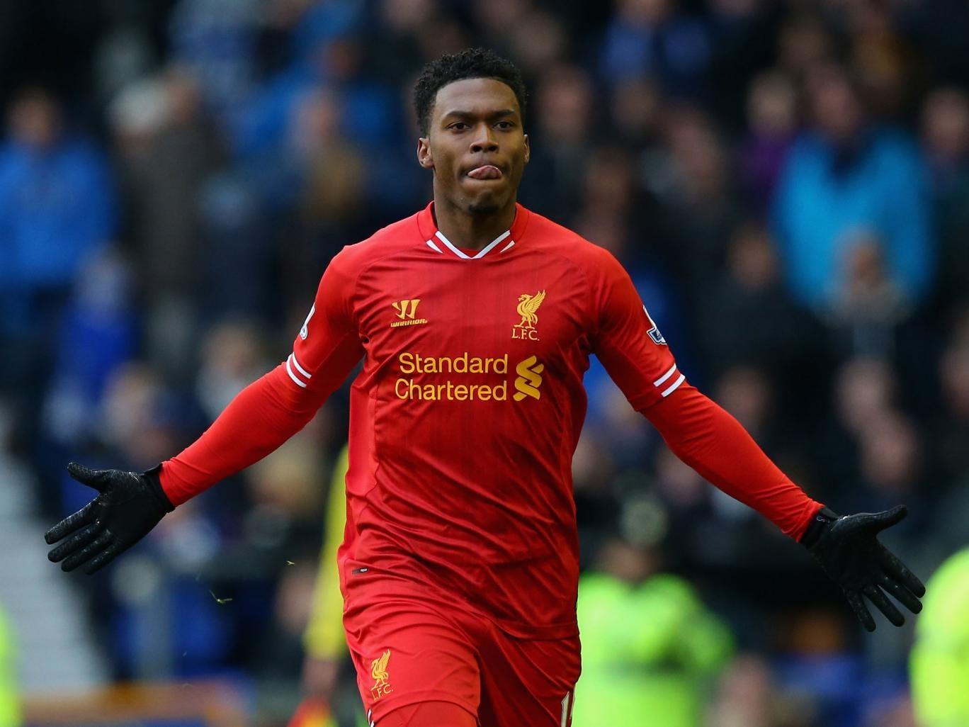 Daniel Sturridge celebrates after scoring an equaliser for Liverpool against Everton