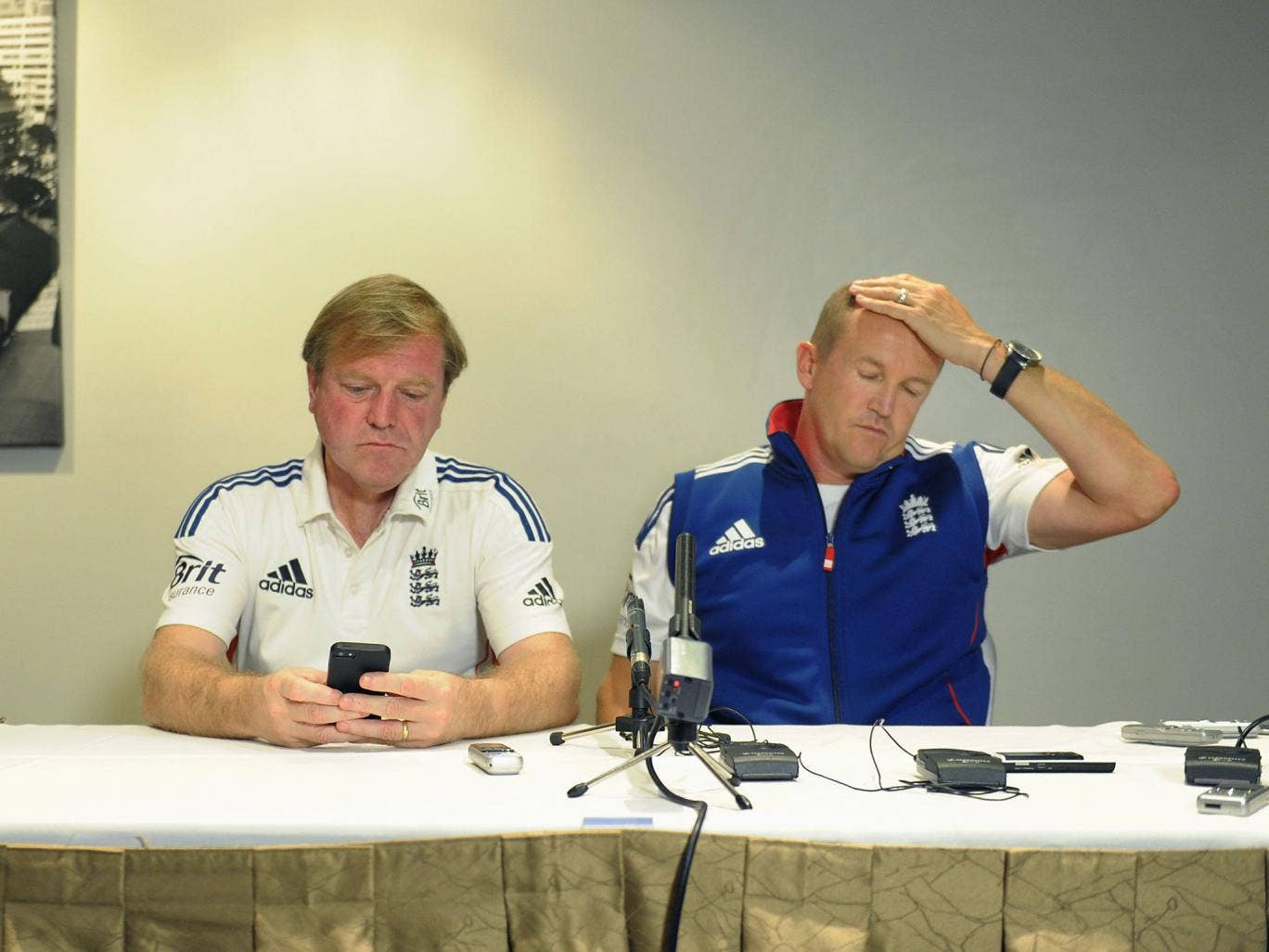 England's managing director of cricket, Hugh Morris (left), and head coach, Andy Flower, face the media in Brisbane following Jonathan Trott's decision to pull out of the Ashes tour