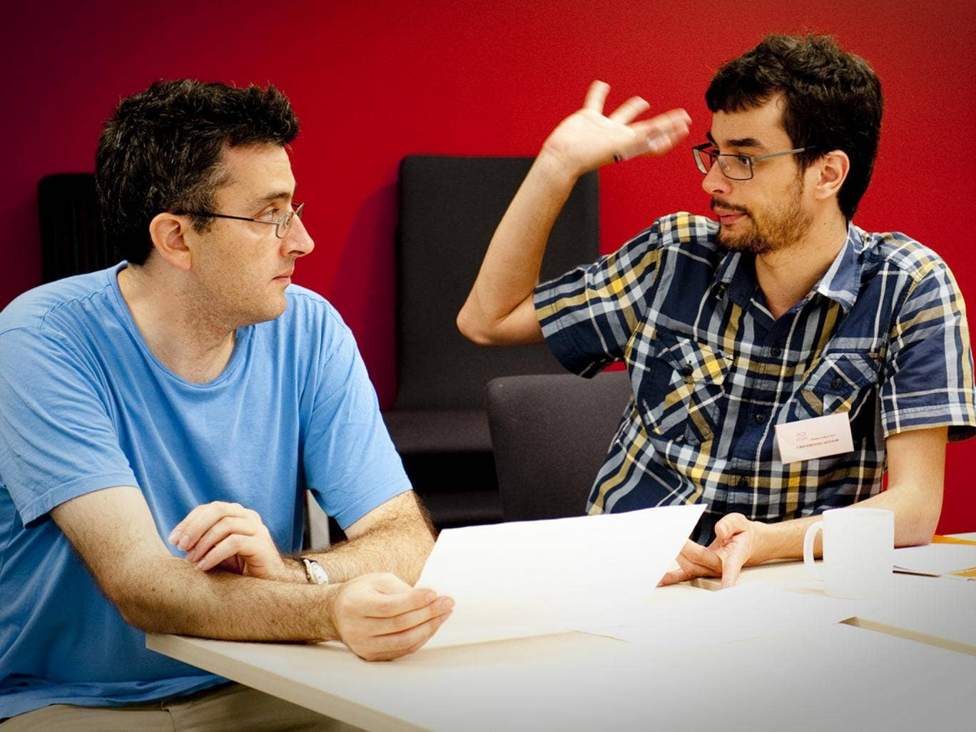 Found in translation: Daniel Hahn (left) stares down a wordy foe in a duel