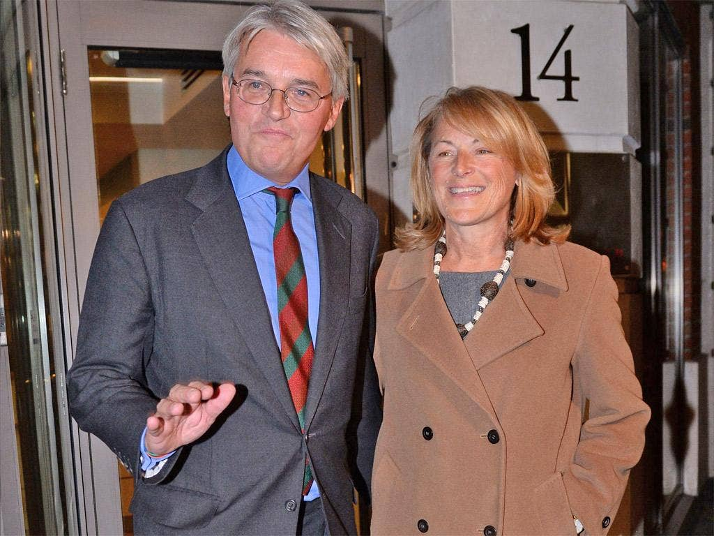Andrew Mitchell and his wife, Dr Sharon Bennett, leave the press conference