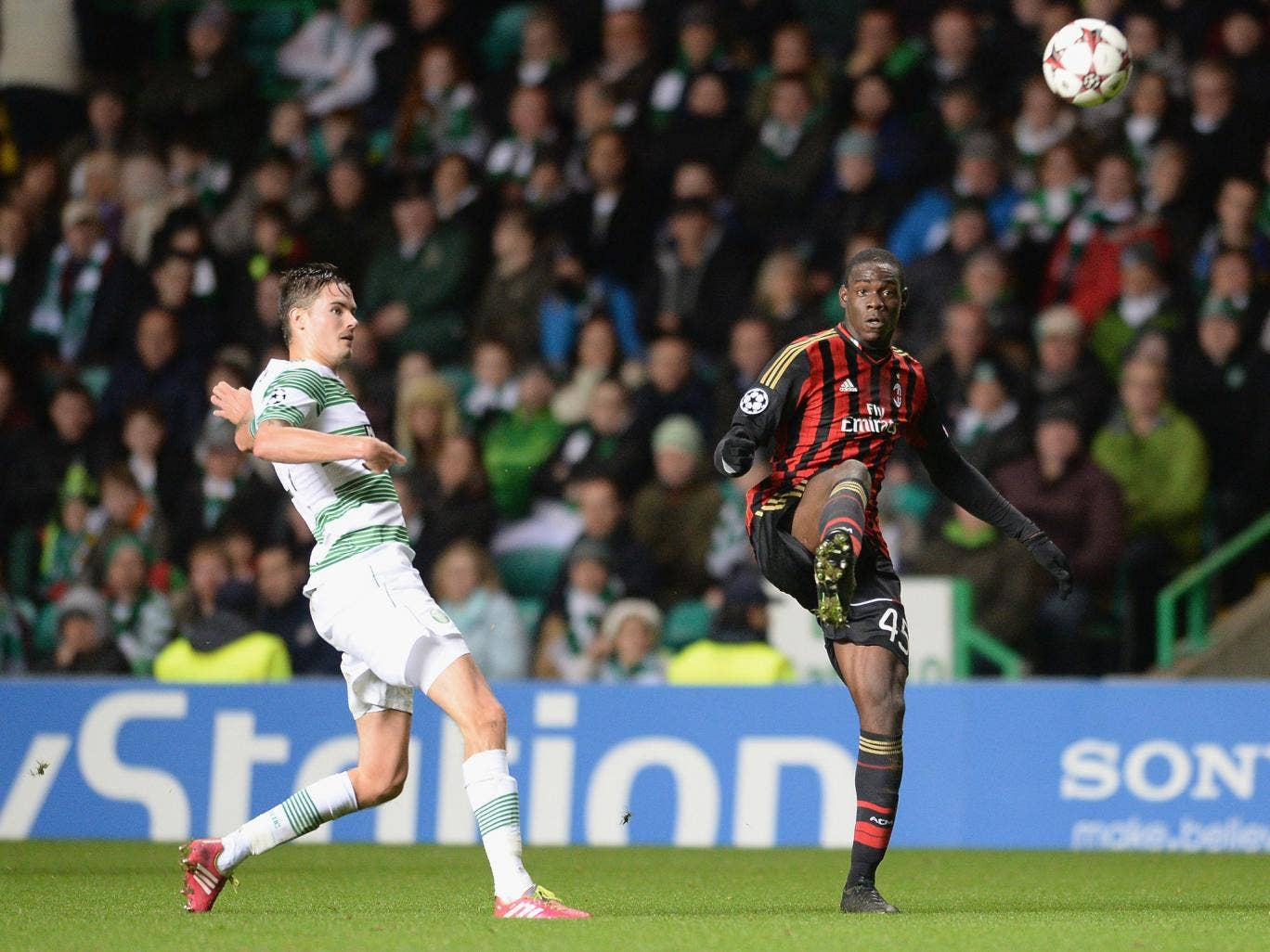 Mikail Lustig is powerless to stop AC Milan striker Mario Balotelli having an effort on the Celtic goal
