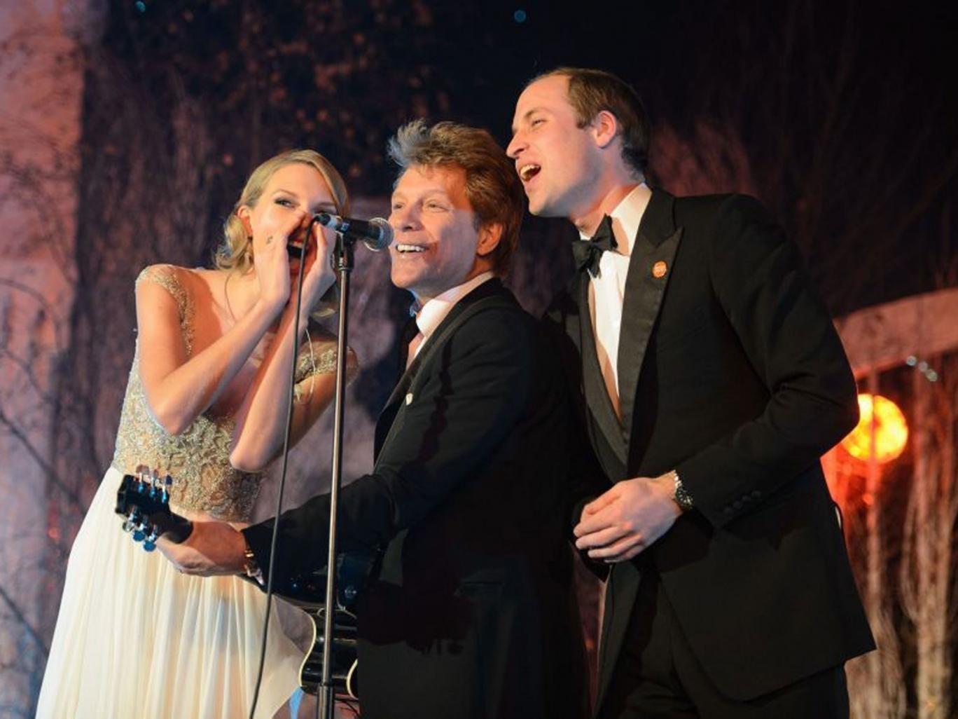 The Duke of Cambridge singing with Taylor Swift and Jon Bon Jovi at the Centrepoint Gala Dinner at Kensington Palace, London