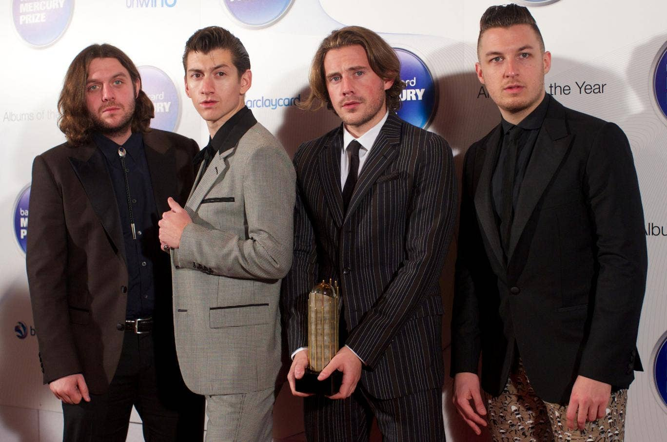 Arctic Monkeys pose with their Albums of the Year trophy at the 2013 Mercury Prize