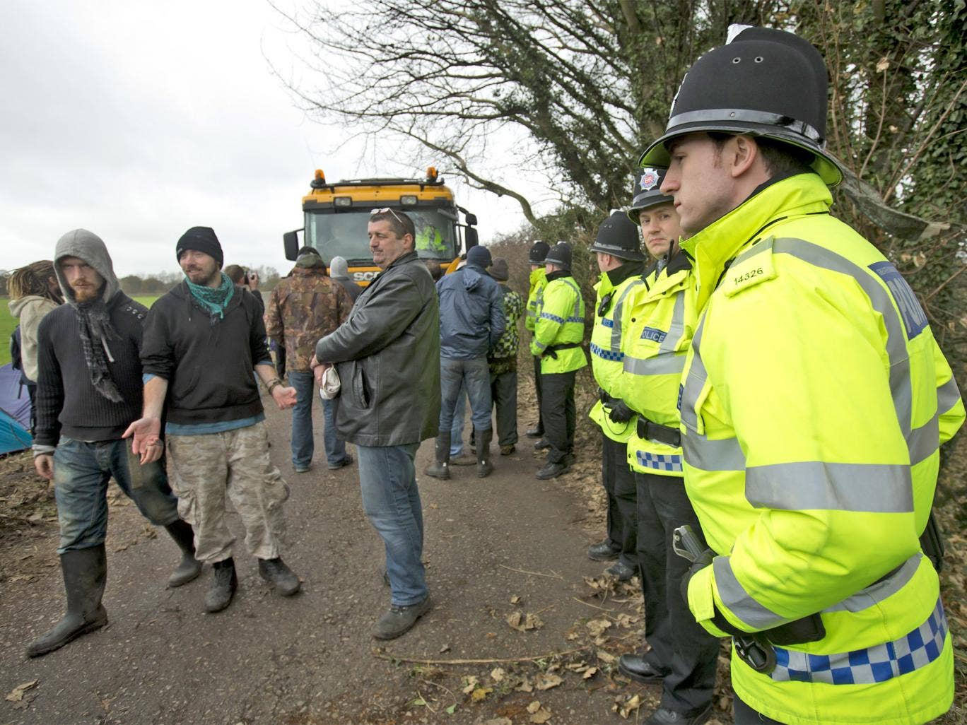 Protesters try to obstruct a lorry making its way down Barton Moss Road