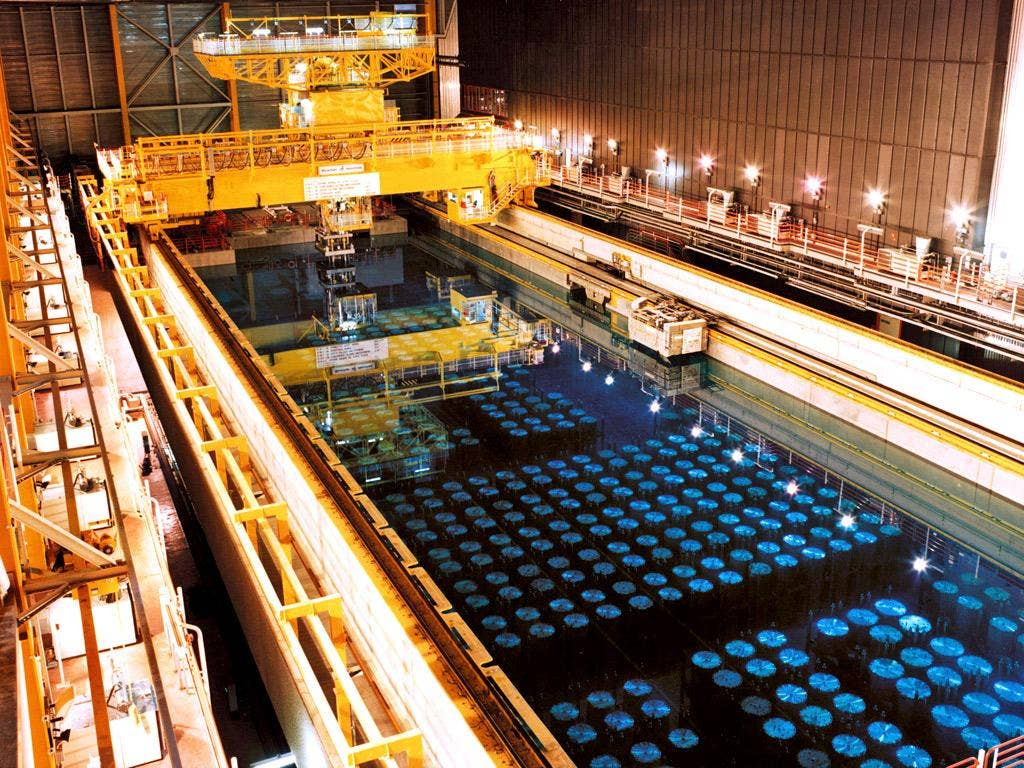 Barrels containing high level radioactive nuclear waste are stored in a pool to keep cool before being reprocessed at Sellafield nuclear plant
