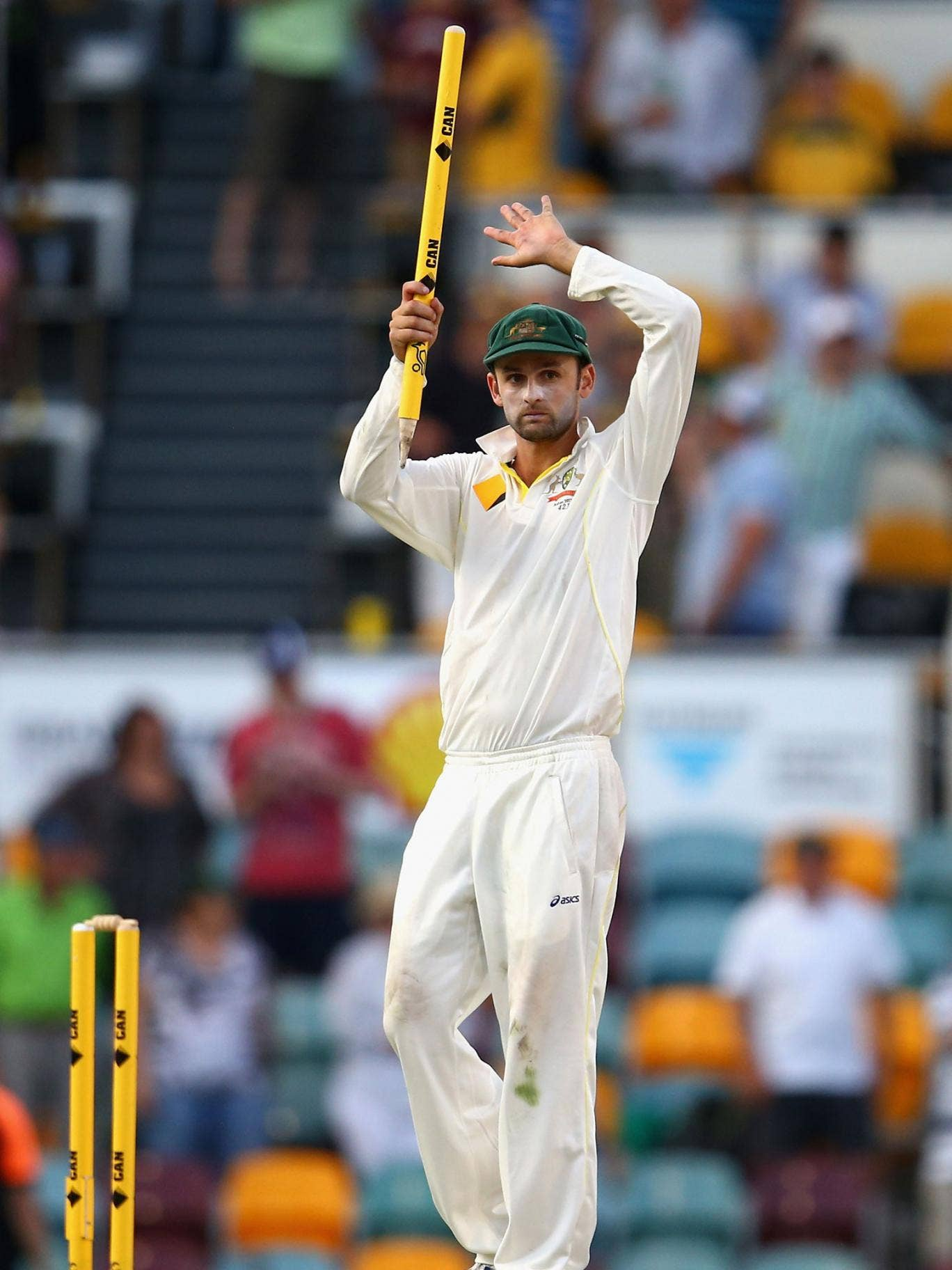 Nathan Lyon claims the spoils of victory at The Gabba