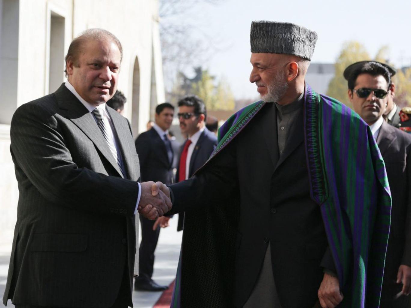 Afghan President Hamid Karzai with Pakistan Prime Minister Nawaz Sharif after talks in Kabul