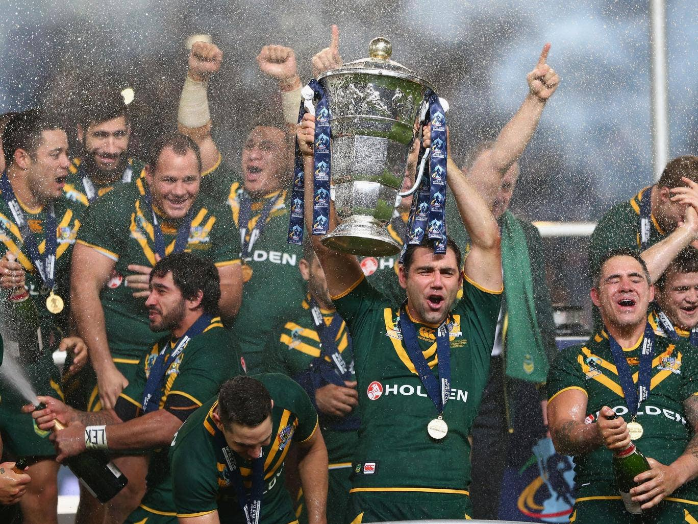 Captain Cameron Smith lifts the trophy