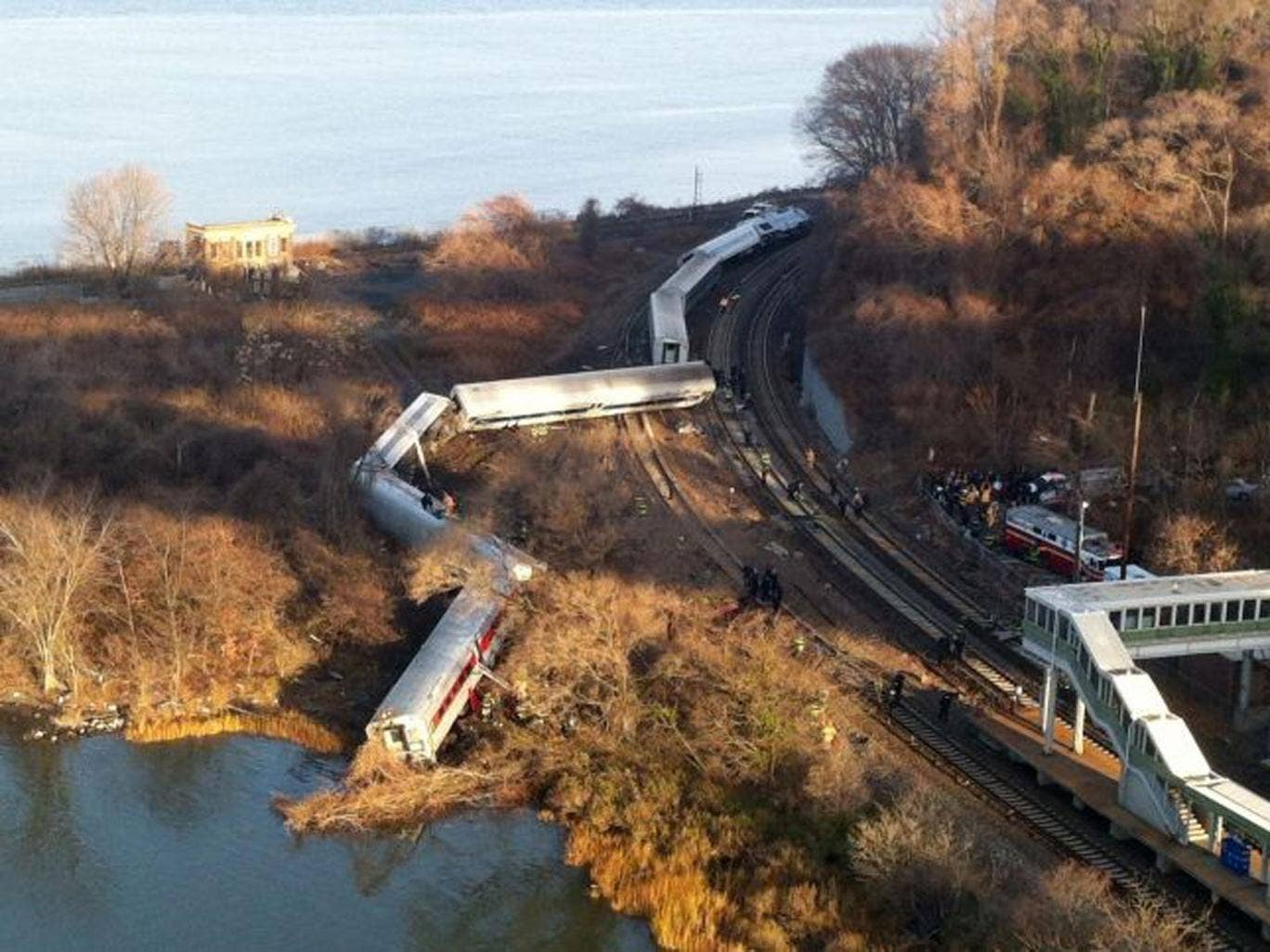Cars from a Metro-North passenger train are scattered after the train derailed in the Bronx neighborhood of New York
