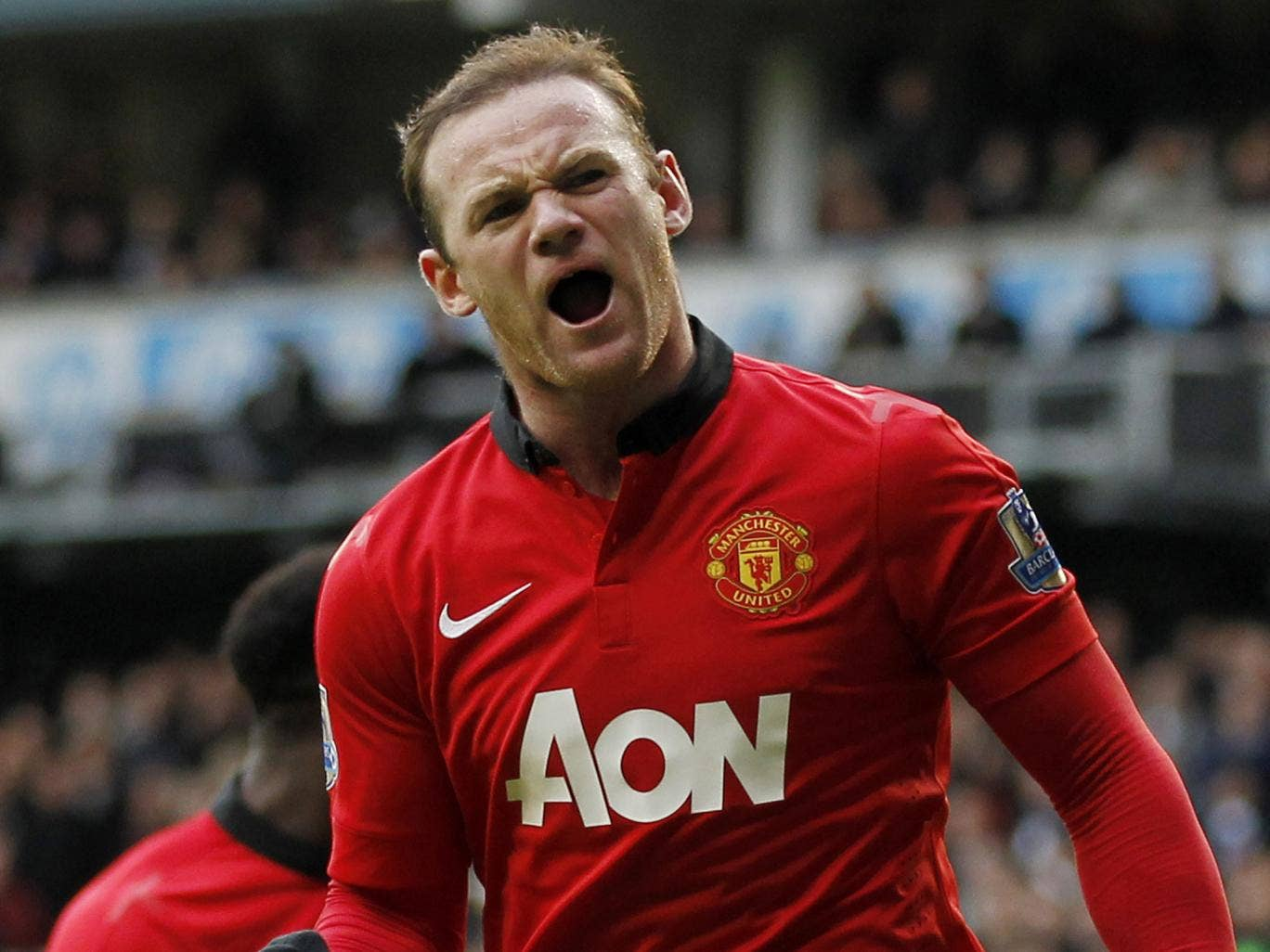 Wayne Rooney celebrates scoring his second from the penalty spot against Tottenham