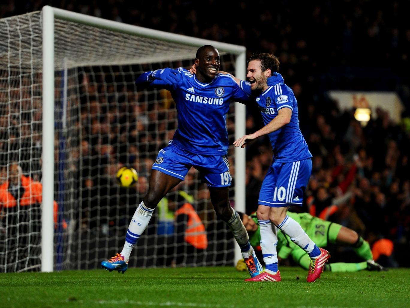 Demba Ba (left) celebrates with team-mate Juan Mata after scoring Chelsea's third goal against Southampton