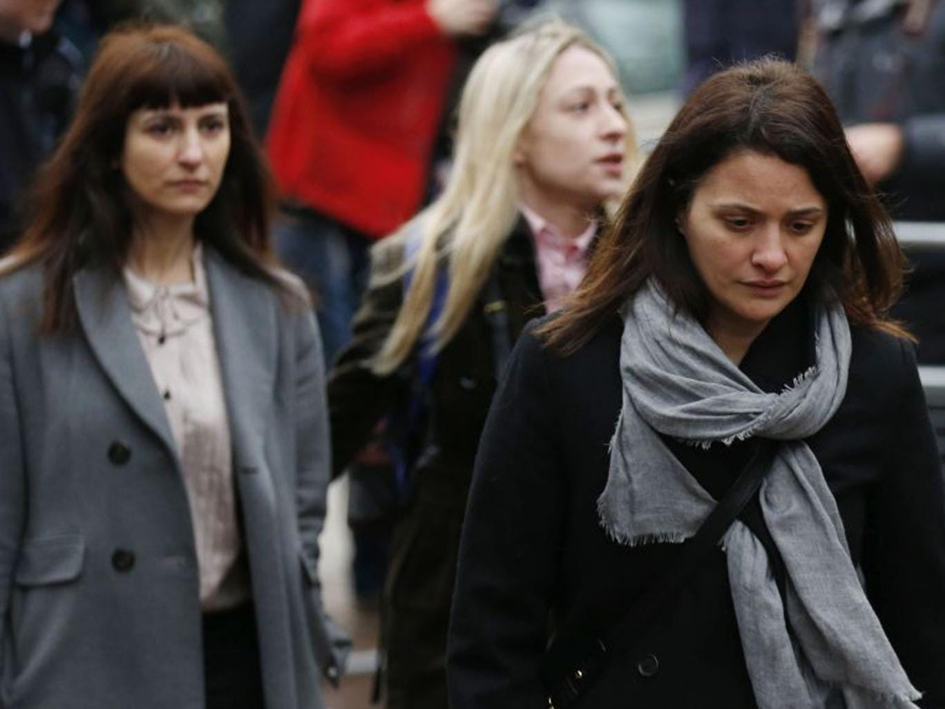 Elisabetta Grillo, foreground, and Francesca Grillo, left, are accused of abusing their positions by using credit cards loaned to them by Ms Lawson and her former husband Charles Saatchi