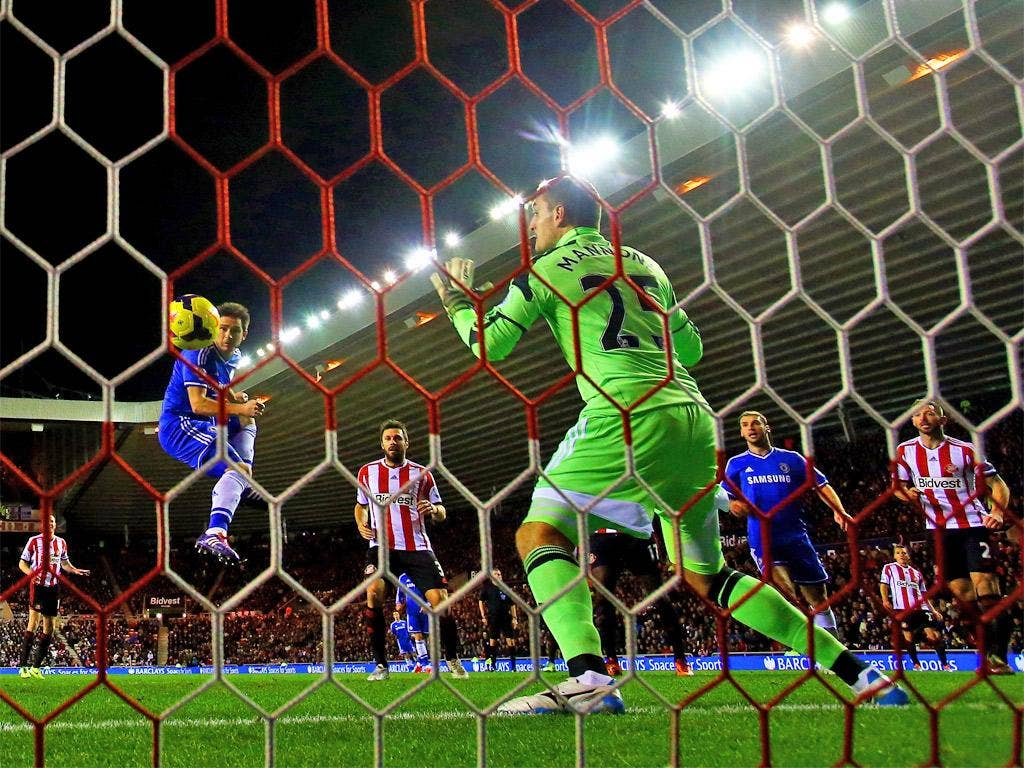Frank Lampard uses his head to score Chelsea's first
