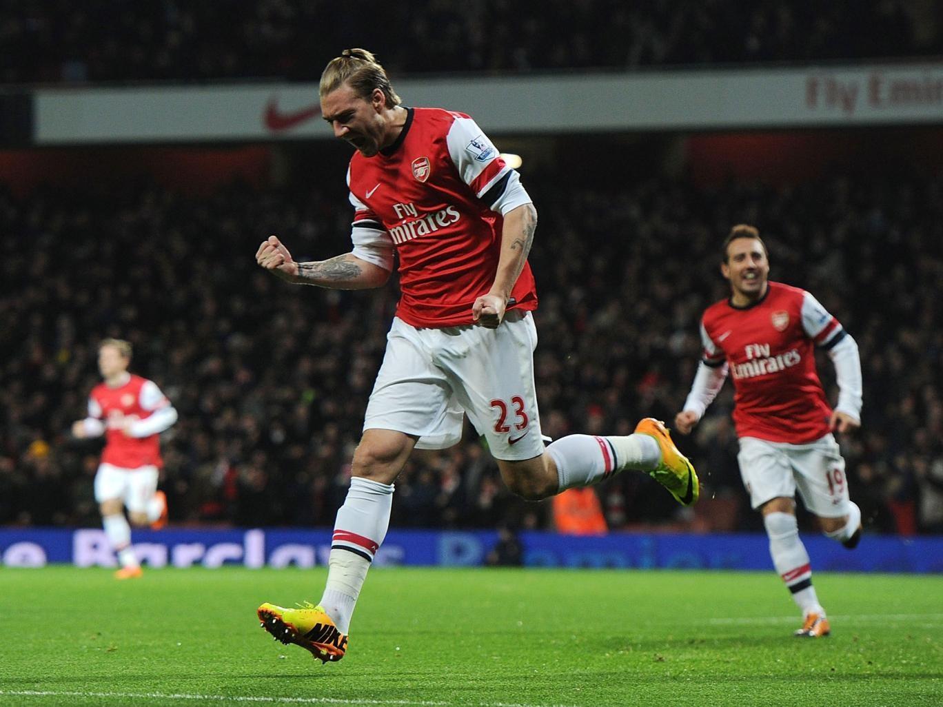 Arsenal striker Nicklas Bentdner celebrates after he scores against Hull City