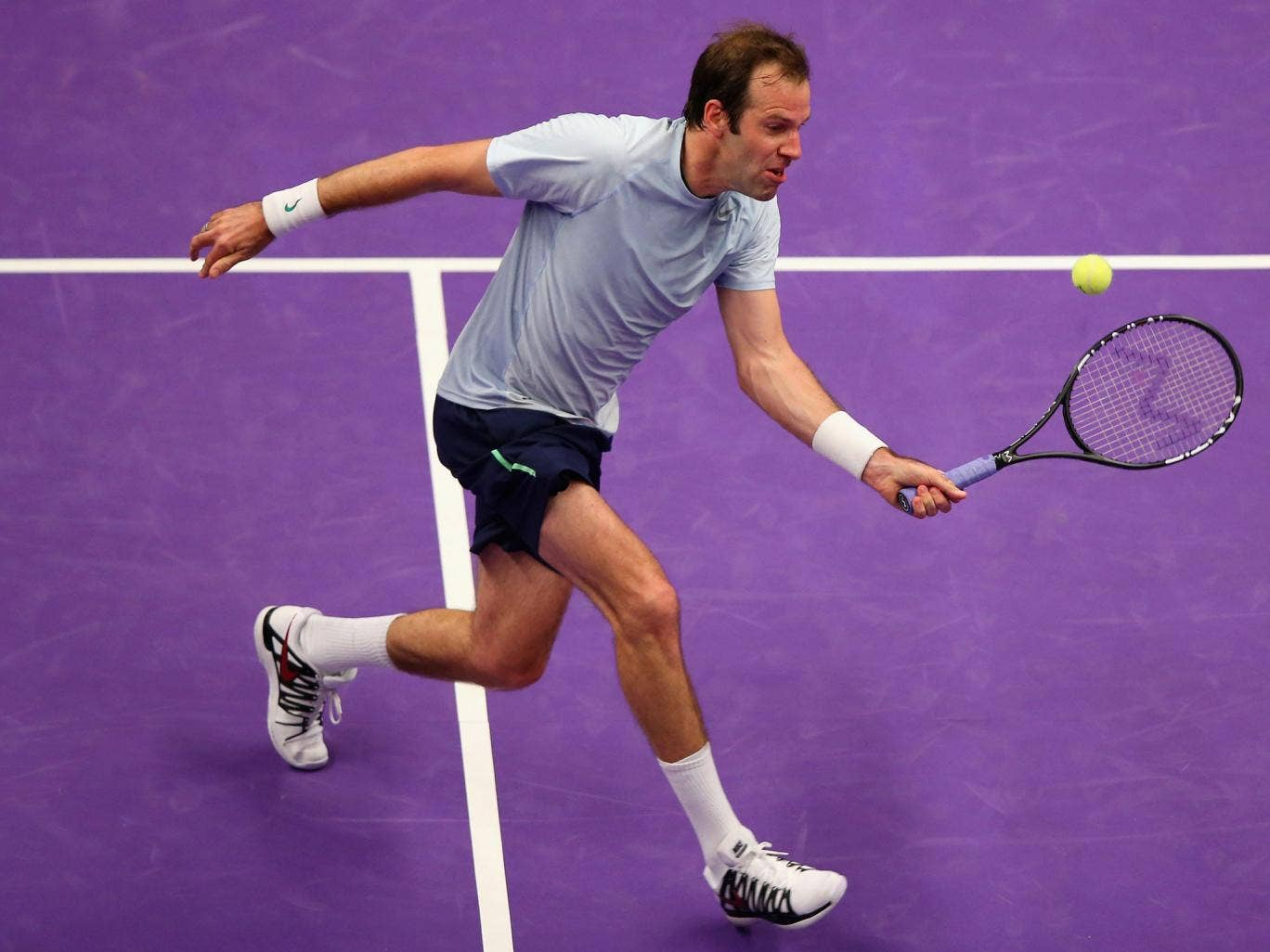 Greg Rusedski plays a forehand during his match against Pat Rafter at the Royal Albert Hall
