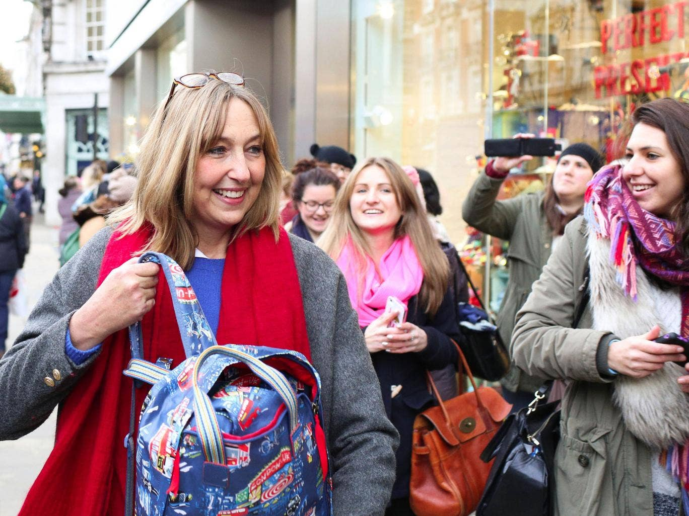 Cath Kidston talks to members of the public in the queue outside her new flagship store in Piccadilly, central London