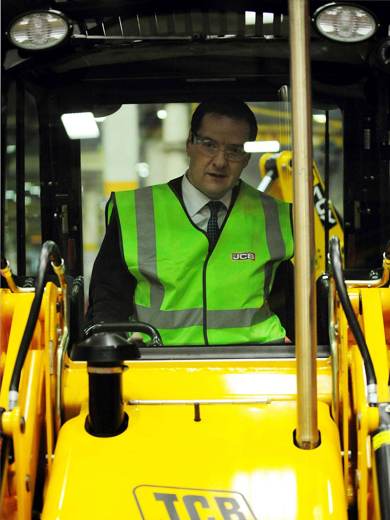 George Osborne visits a JCB factory in Staffordshire. Critics say he has got his sums wrong