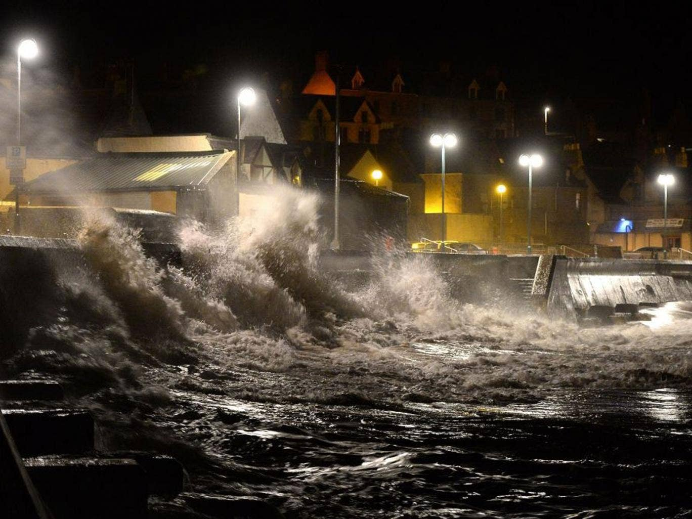 Huge waves pound Eyemouth harbour in Scotland during the storm surge